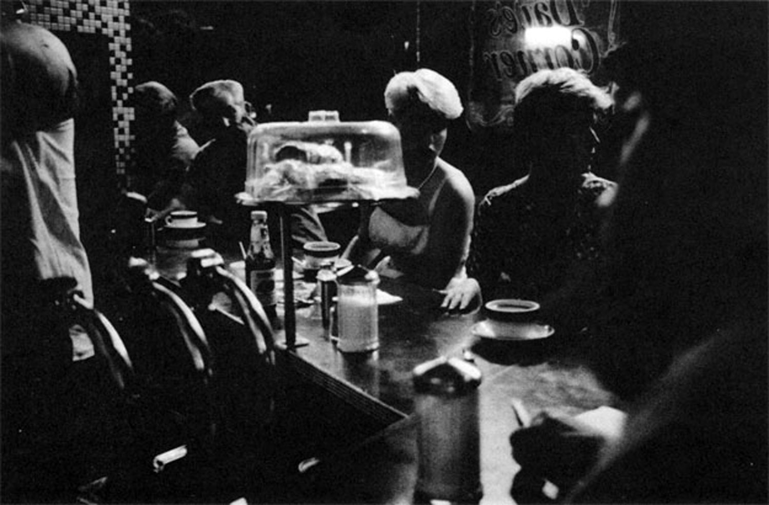 A late night at Dave's Corner, an all-night coffee shop two blocks from the Mudd Club where nightclubbers mixed with nightshift workers. Photo by George Shustowicz