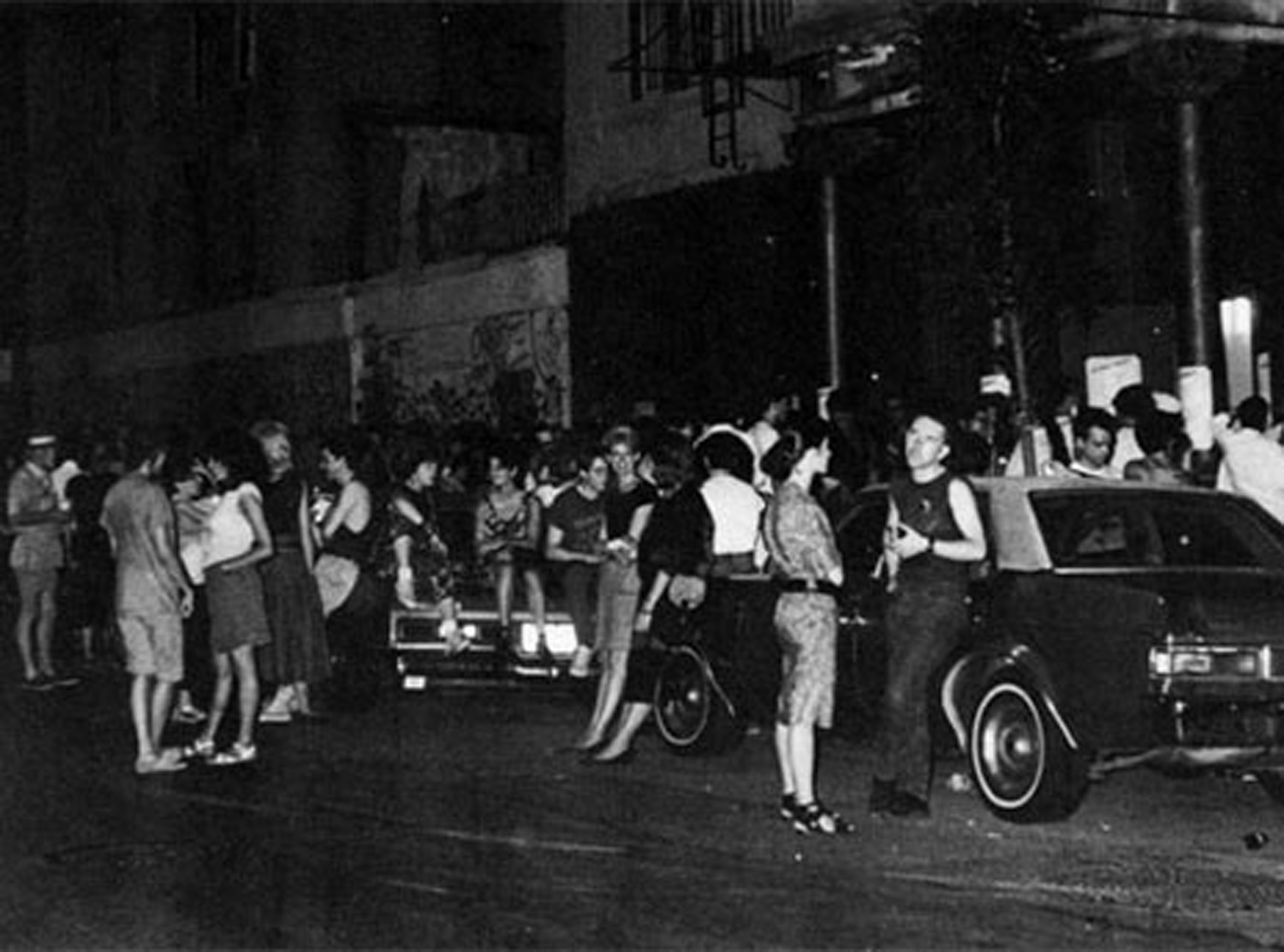 "An East Village gallery opening spills over out front of Kenkeleba House on East 2nd Street for Steve Kaplan's ""Chill Out"" group show, Summer, 1984. Photo by Ann Messner"