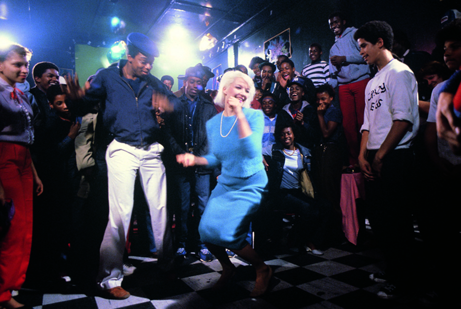 Patti Astor hunkers down in this scene from Charlie Ahearn's 1982  Wild Style  (First Run Features), a film about the rap and graffiti scene in the South Bronx. Astor was a co-director of the Fun Gallery on East 10th Street. Photo by Martha Cooper