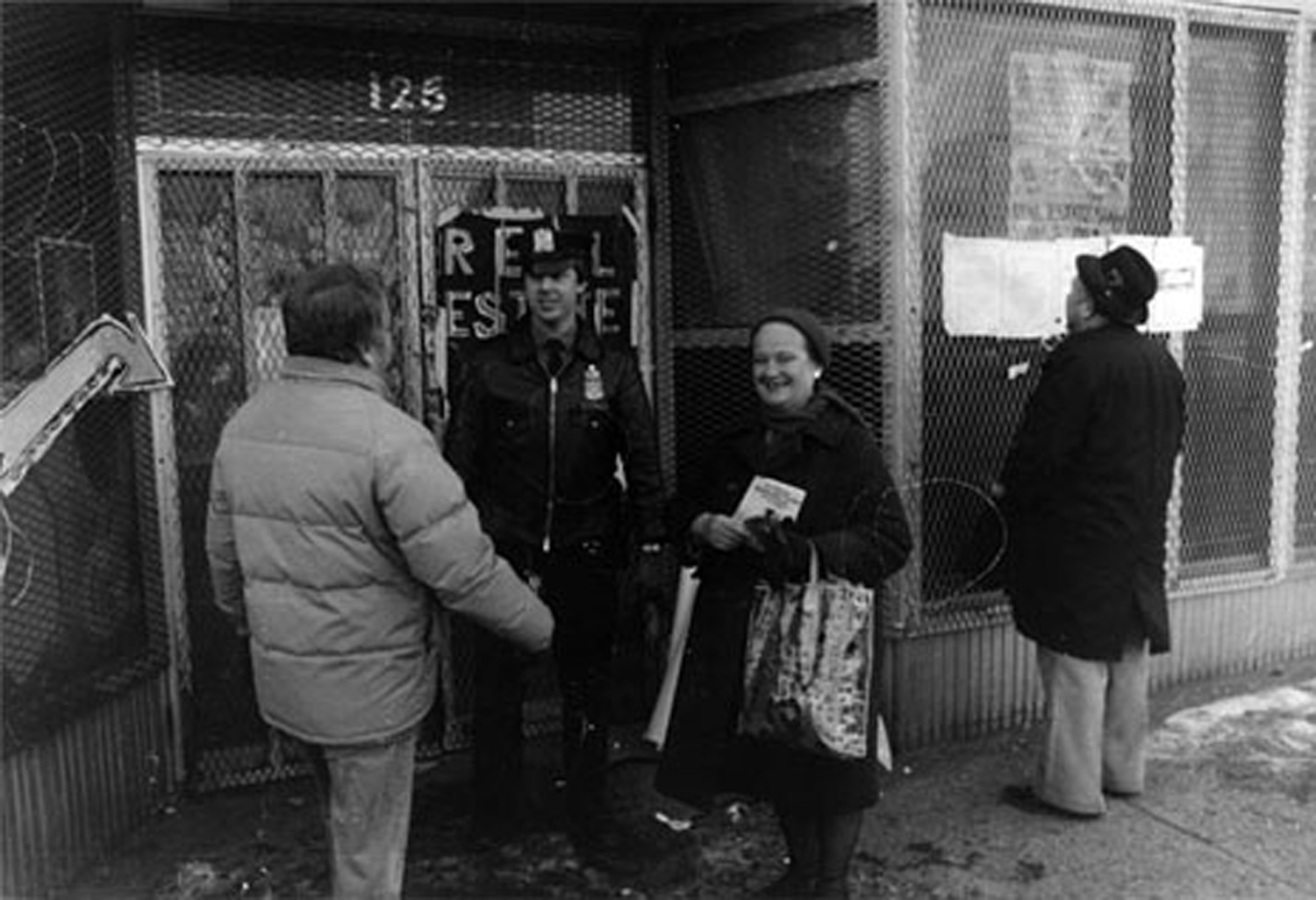 "Scene outside the ""Real Estate Show"" with police guarding the building's doors following the eviction of the artists, 1980. Photo by Lawrence Lehmann"