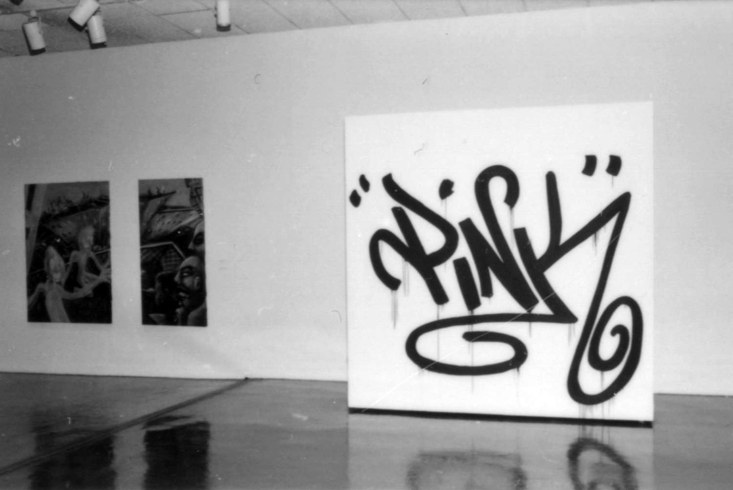 Pink's tag on the moveable wall that shielded the doors to the curatorial offices.
