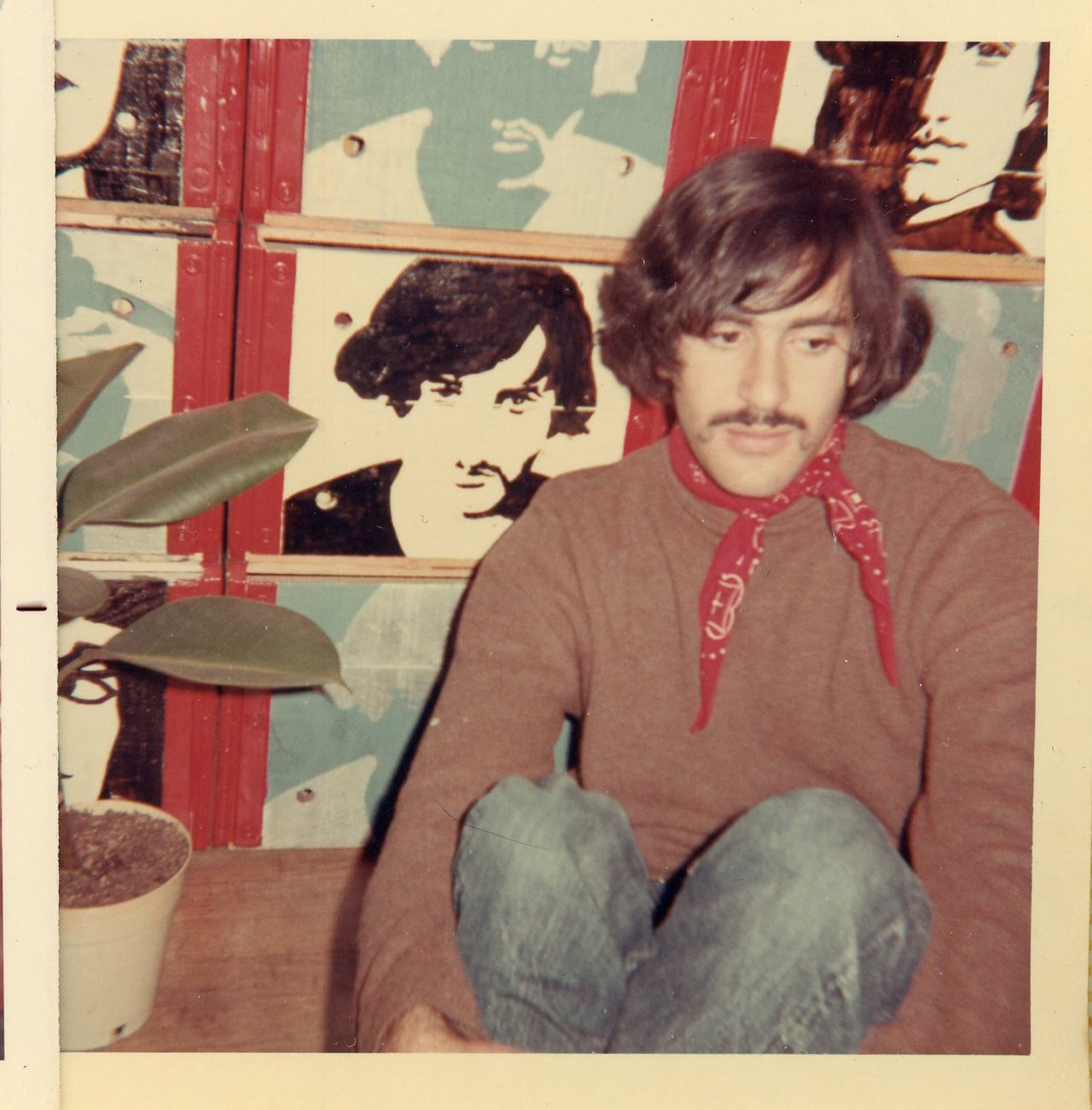 Marc in front of room divider / bookcase made of milk crates, painted by Carla, c. 1969.