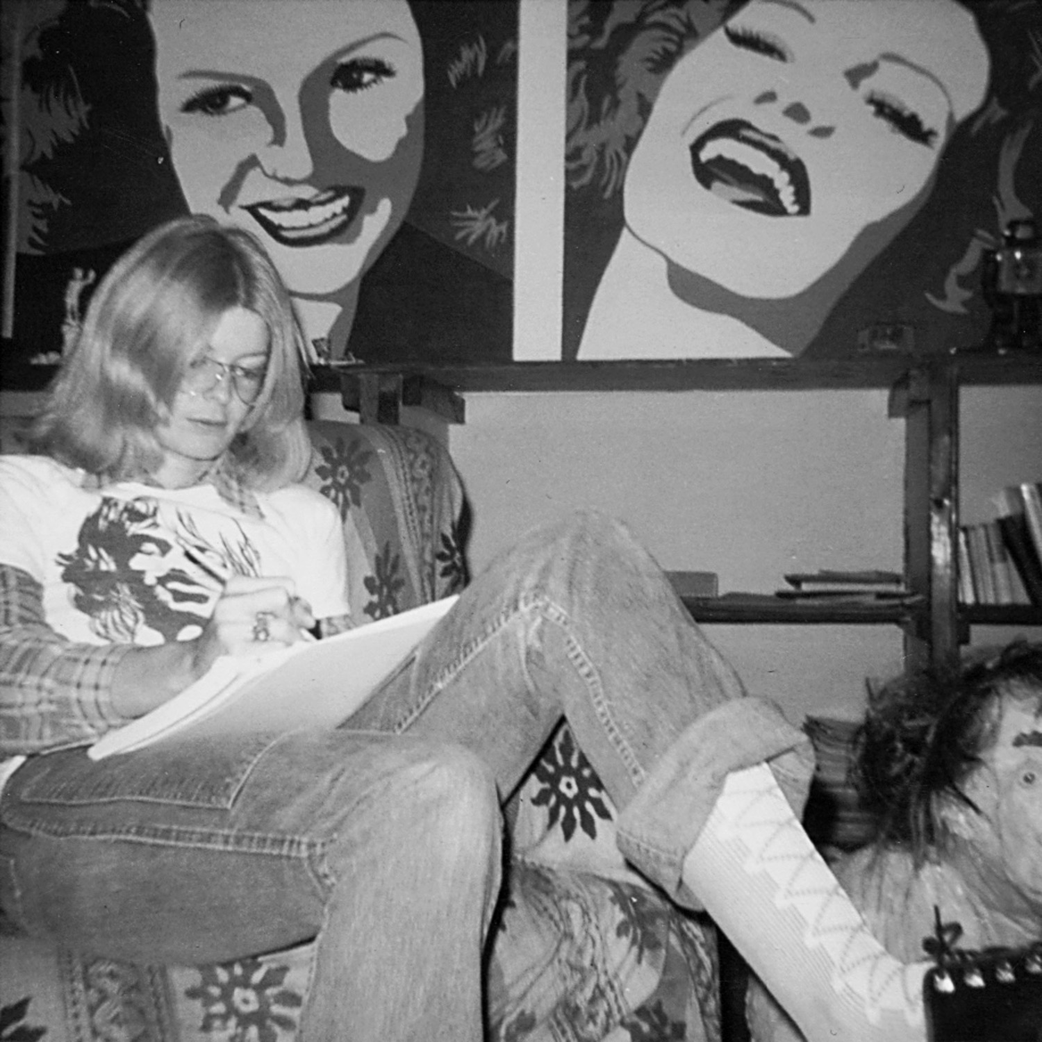 Carla at 98 Bowery (her paintings of Rita Hayworth in the background), c. 1971