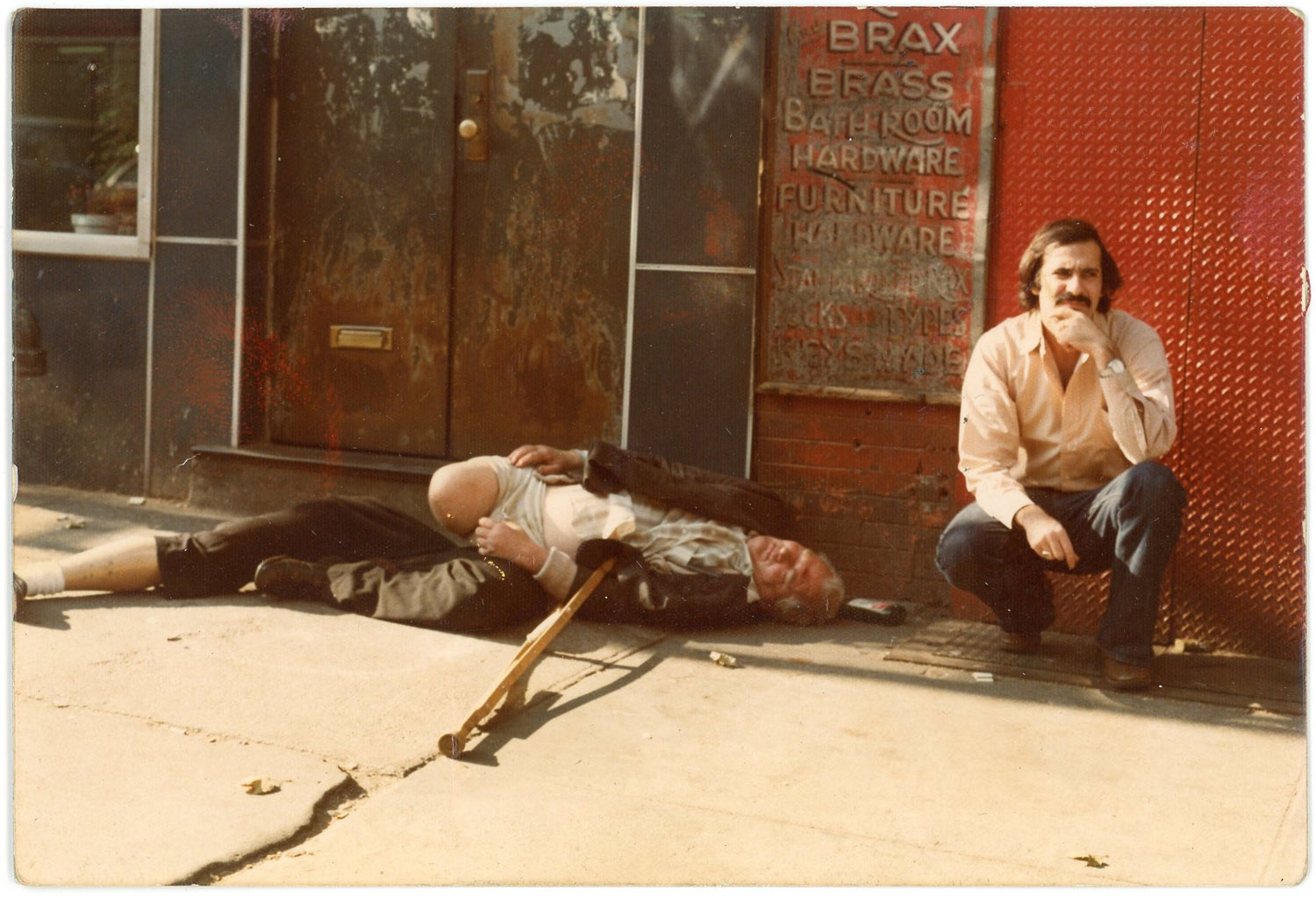 Outside the doorway to 98 Bowery with Harry's Bar to the left, 1975