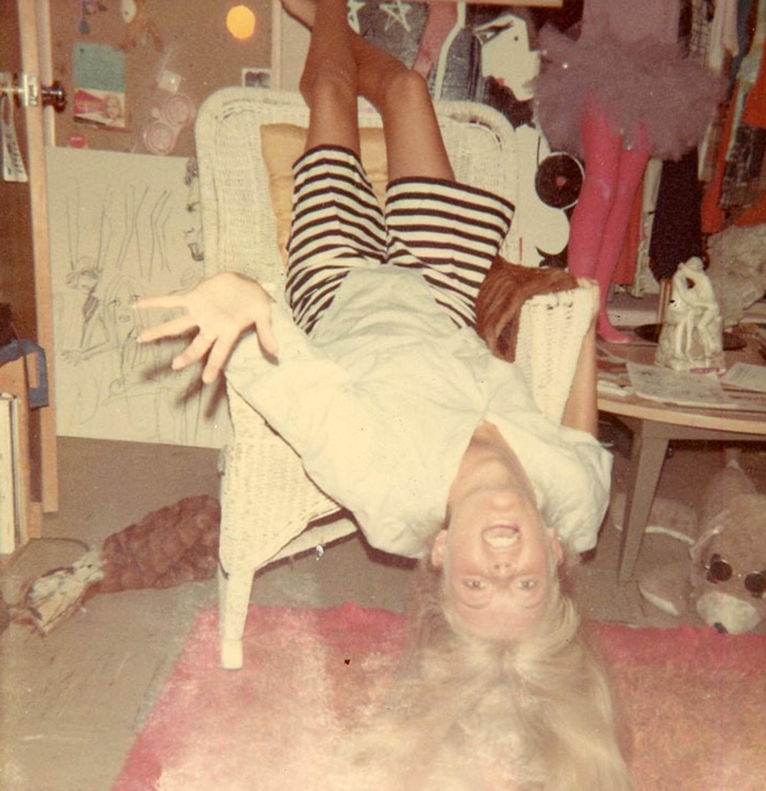 Carla in her childhood bedroom.