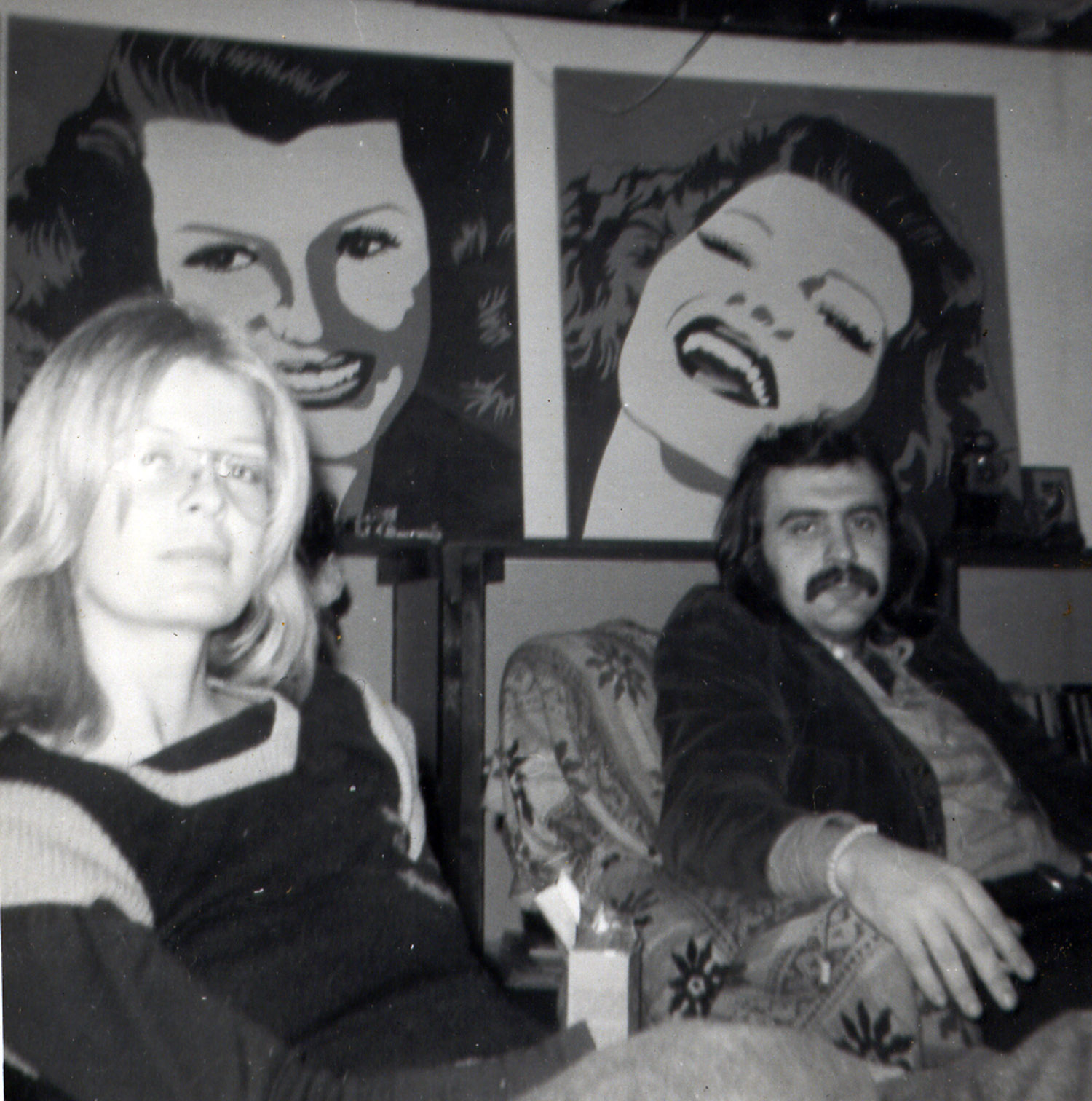 Carla Dee Ellis and Mike Shannon, c. 1970. Carla's paintings of Rita Heyworth in background.