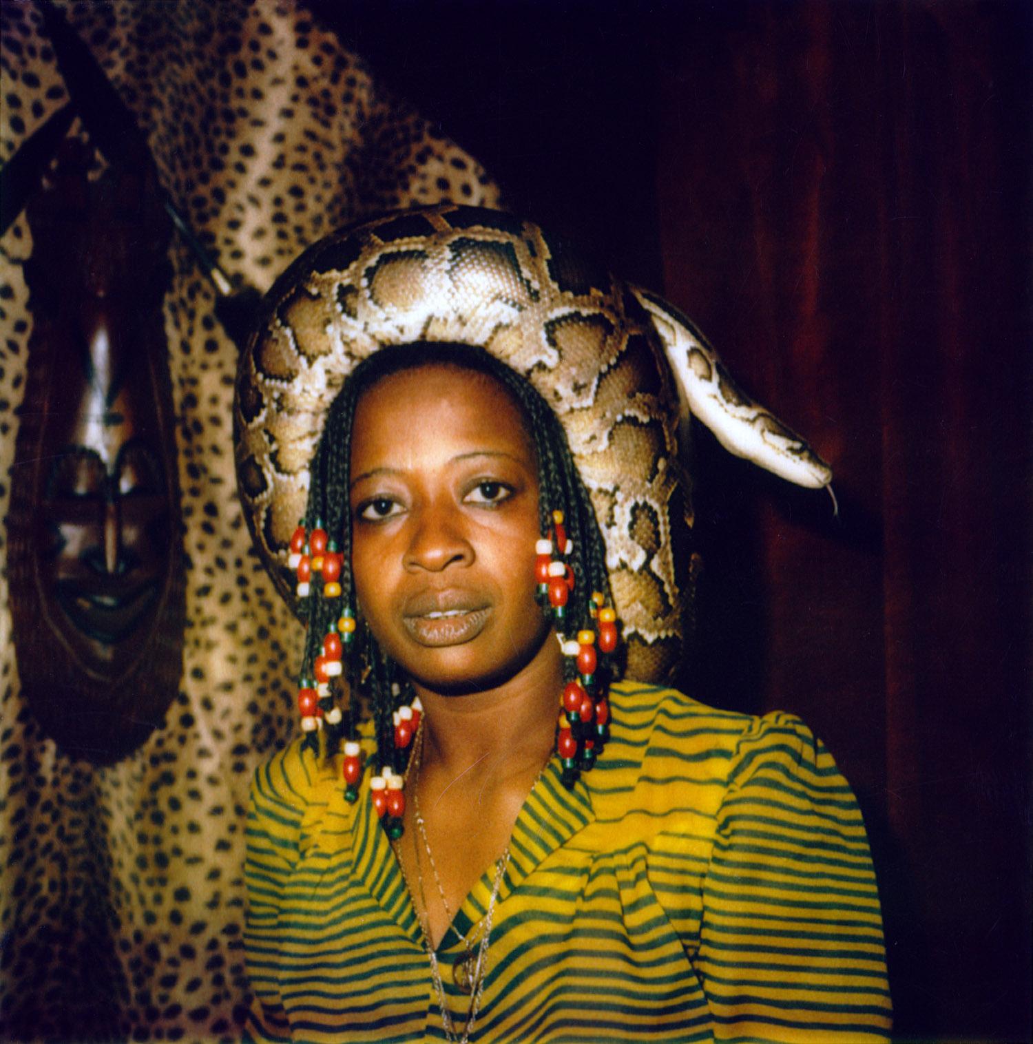 Woman wearing life snake at Chez Tony