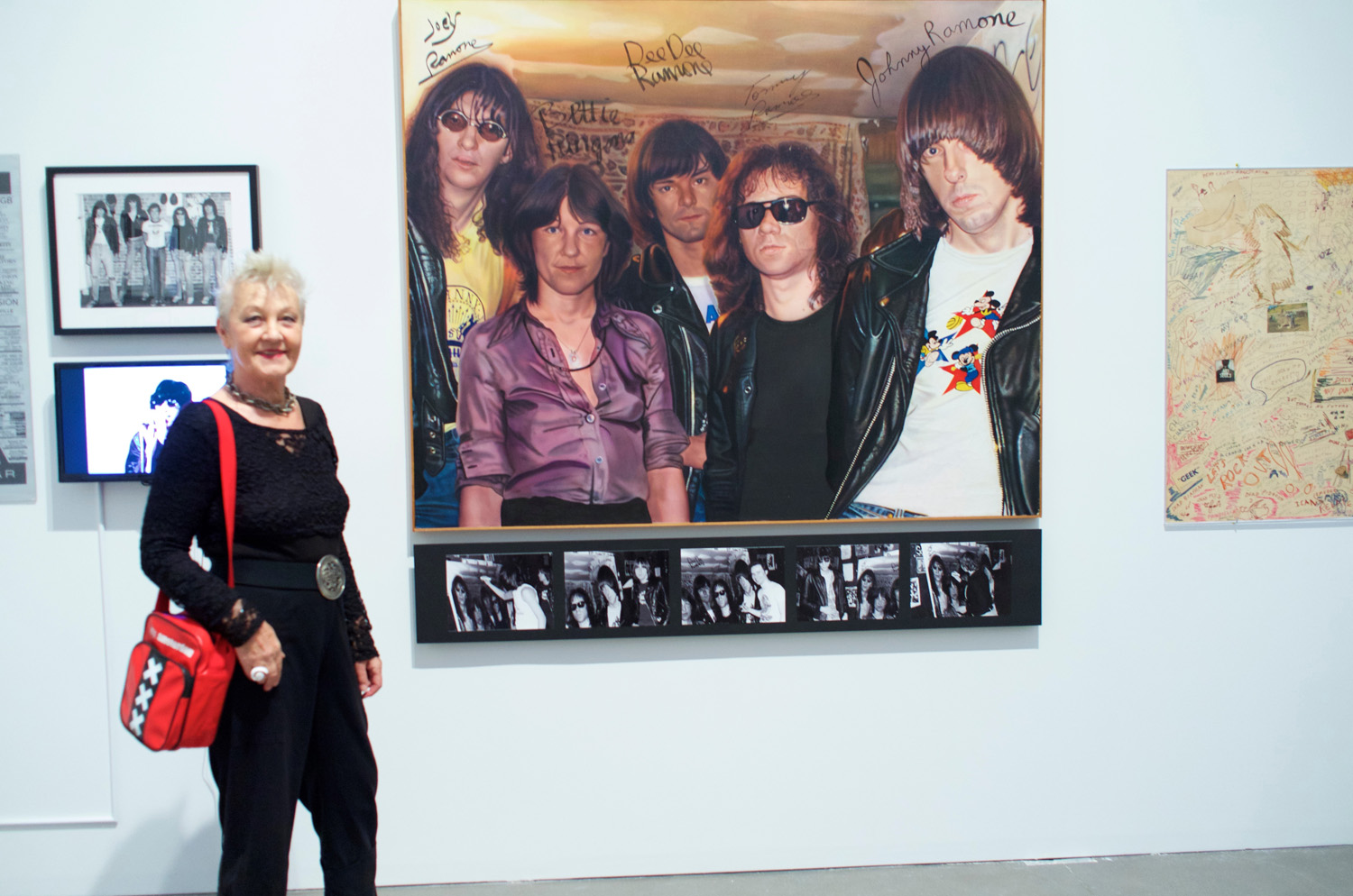 "Bettie Ringma with Curt Hoppe's painting ""Bettie and the Ramones."" Photo by Curt Hoppe."