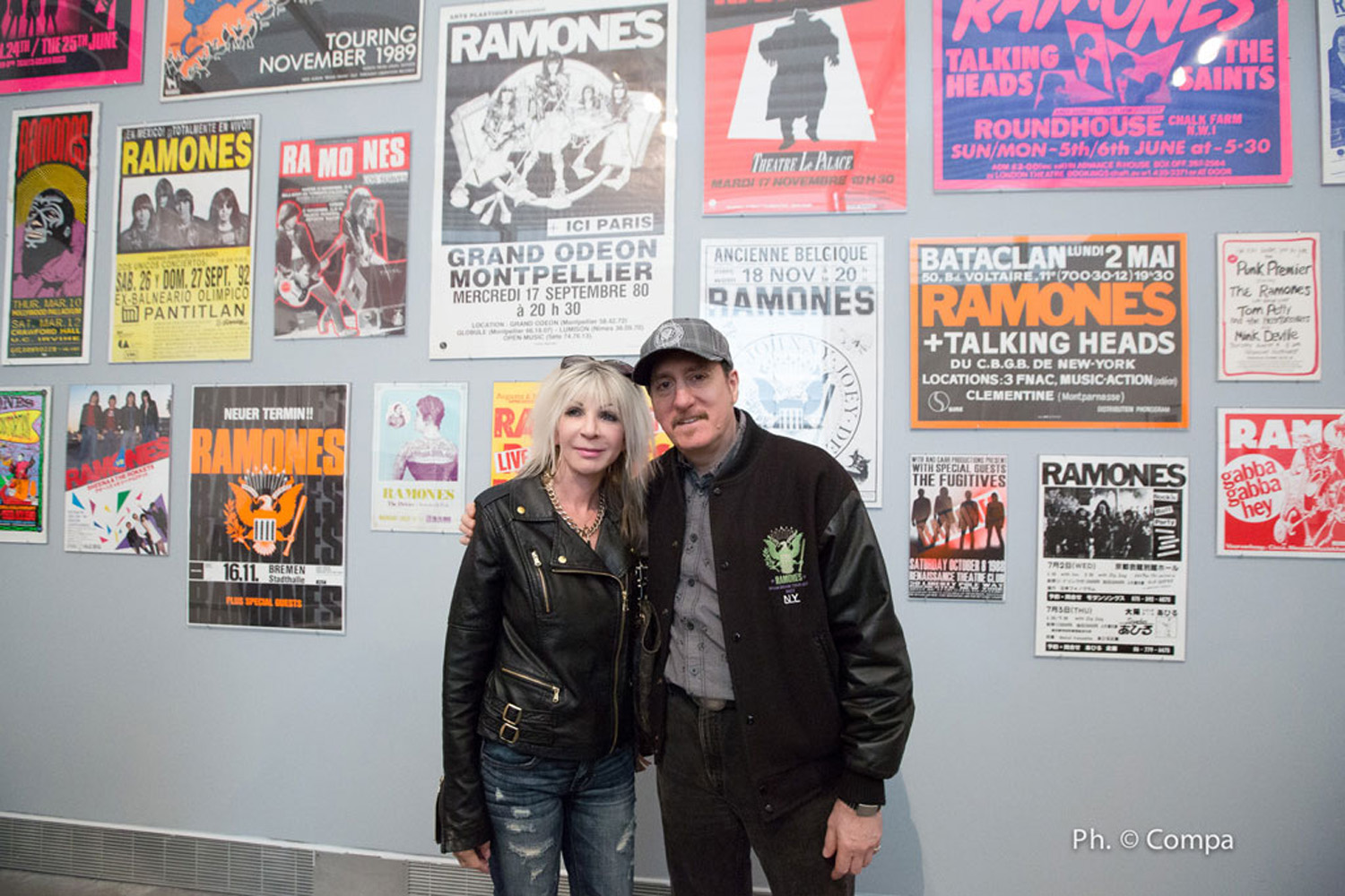 Vera Ramone King (Dee Dee Ramone's first wife) and Monte A. Melnick (Ramones tour manager) in front of a display of Ramones tour posters from Melnick's collection. Photo by Andrea Compa.