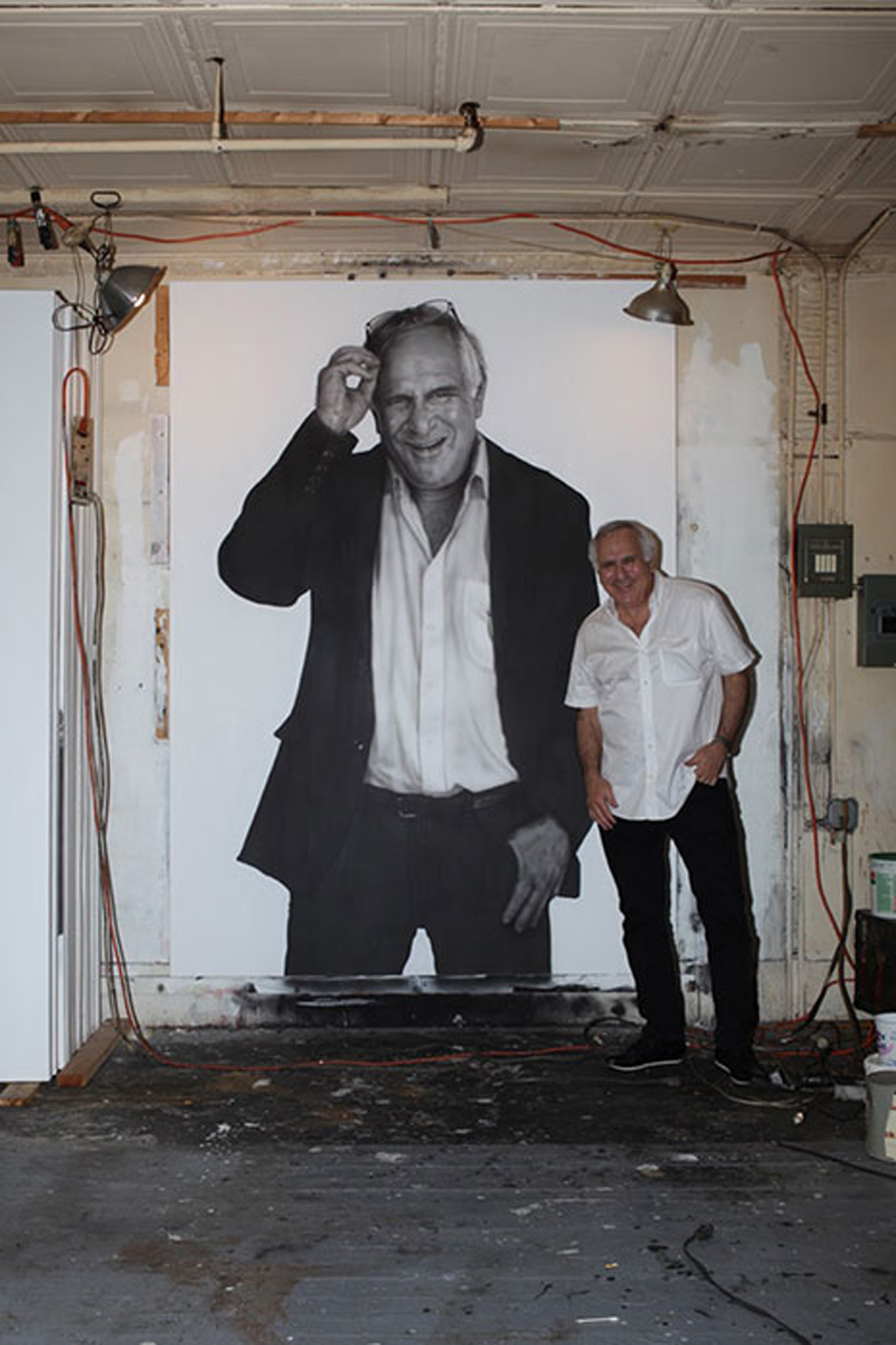 Marc Miller in front of Curt Hoppe's portrait.