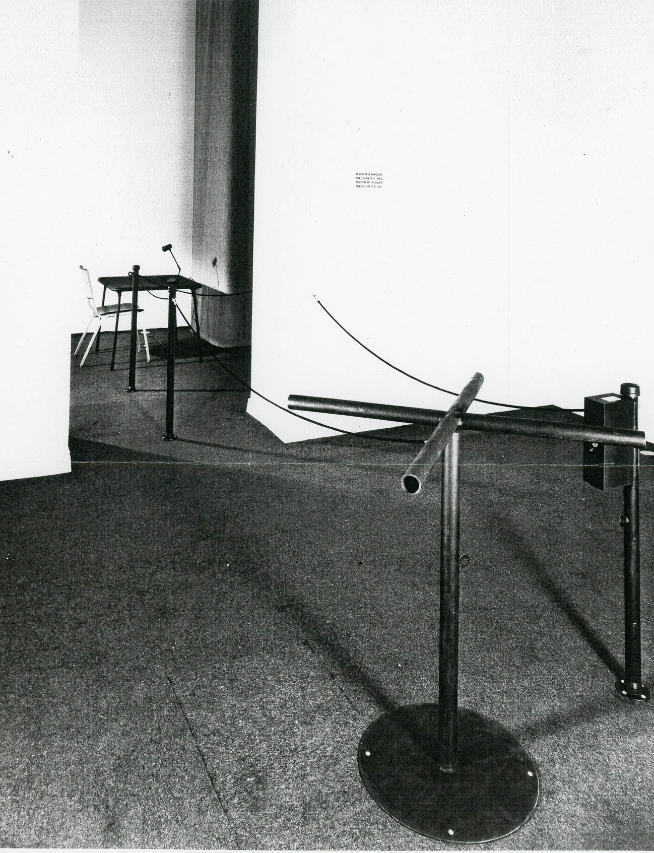 "Photo of ""Insure the Life of an Ant"" installation at OK Harris Gallery; the entryway and assistant's desk (killing machine out of view in room to the right), 1972."
