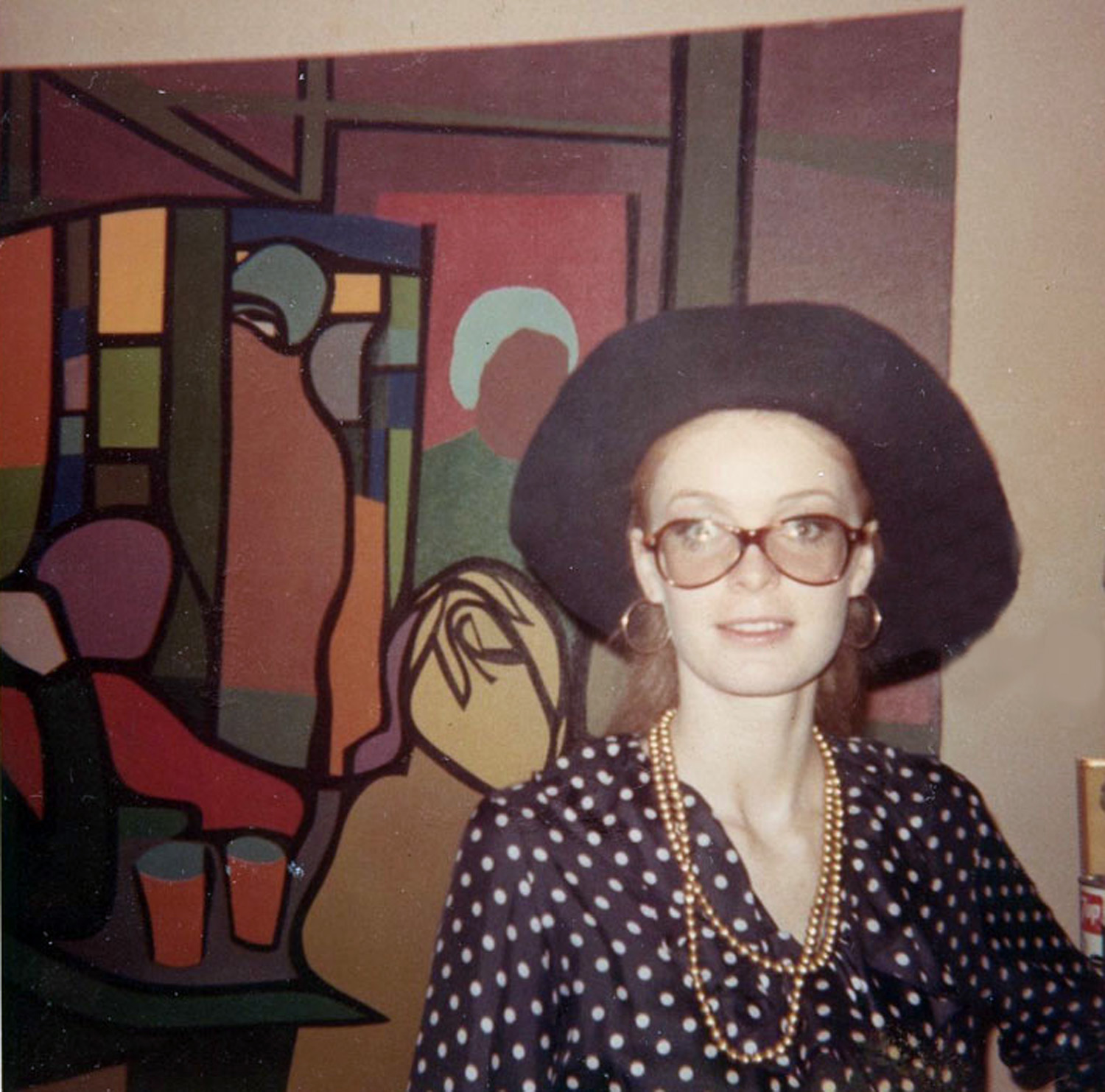Carla Dee Ellis heading off to a modeling assignment. The painting behind her, depicting the cafeteria at SVA, is by John Wilmer, who was the intended first tenet of the loft.