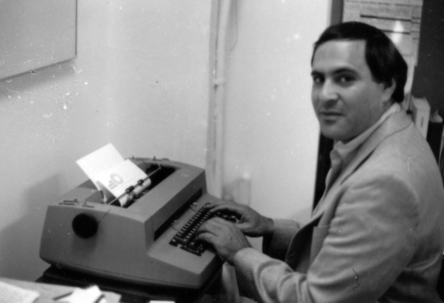 Marc Miller at his IBM Selectric typewriter in his office at the Queens Museum, c. 1986