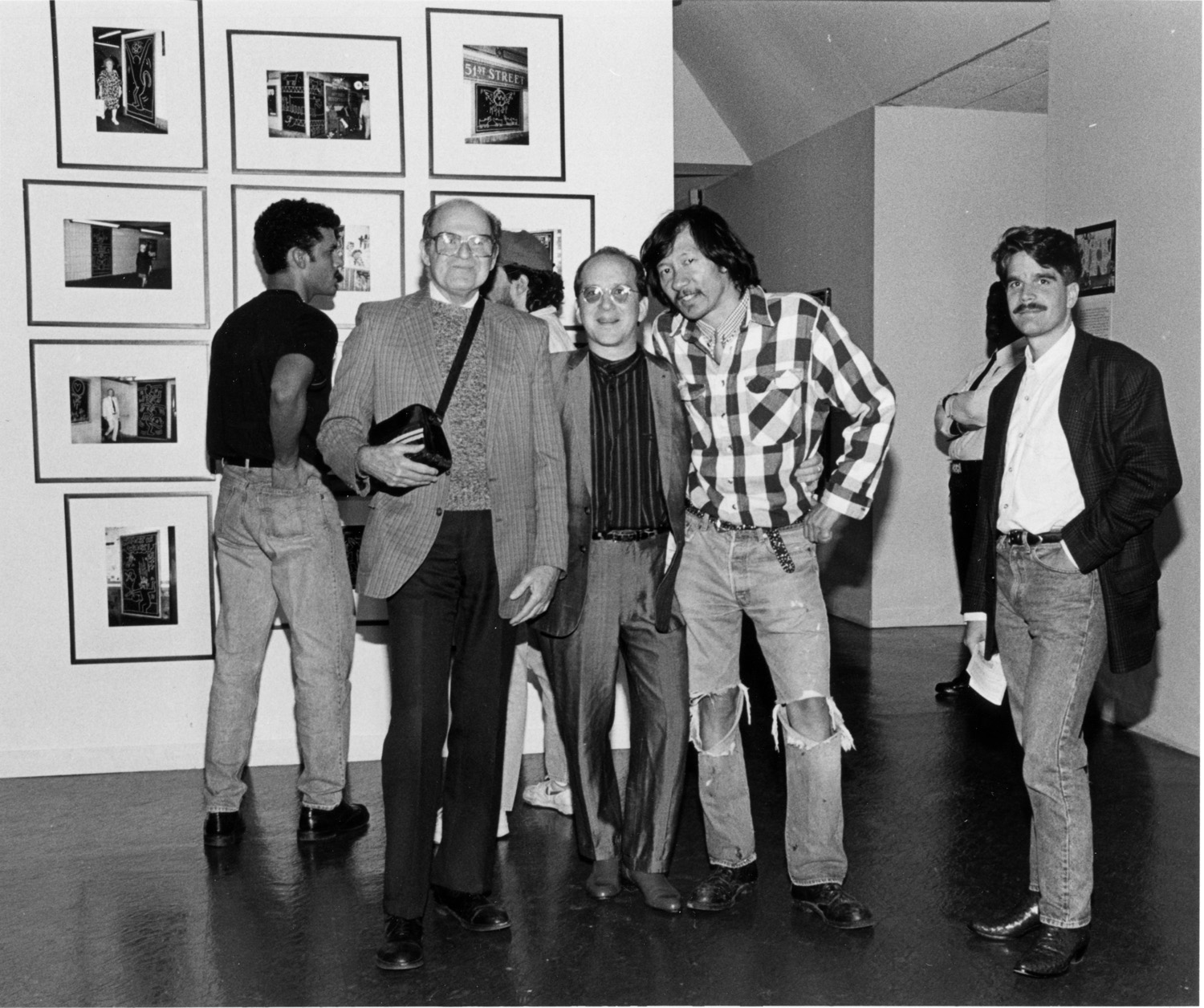 Collector Norman Dubrow (left), guest curator Barry Blinderman (center), and Martin Wong (right) at the opening of  Keith Haring Future Primeval , 1990