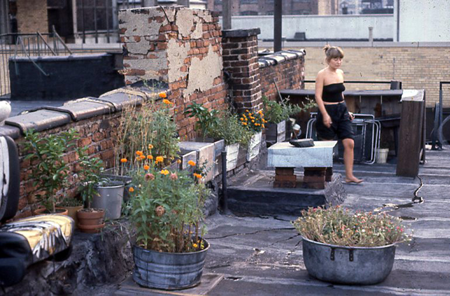 Becky Anderson Hoppe on the roof, c. 1978.
