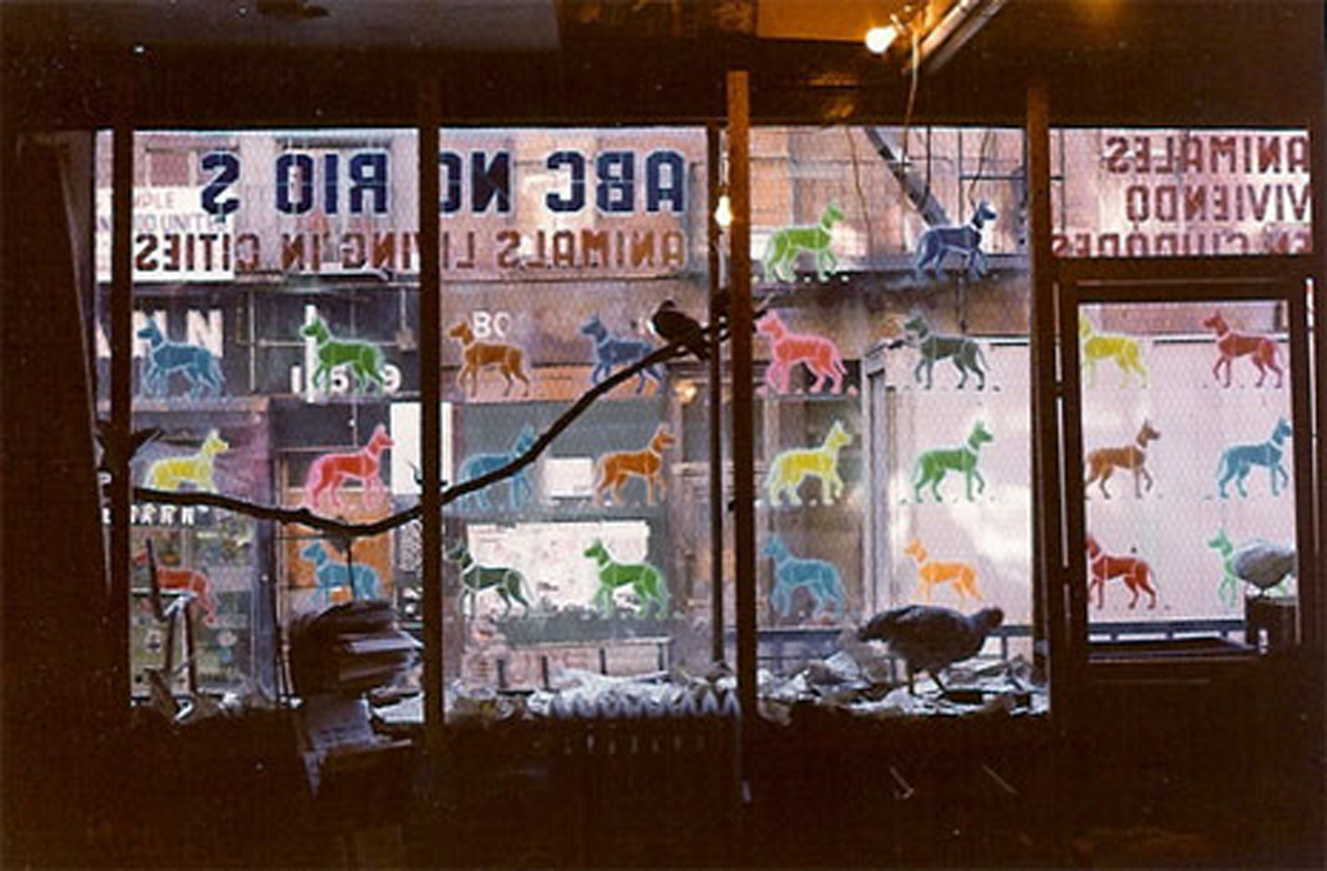 Dog stencils on the front window of ABC No Rio by Anton Van Dalen. Photo by Anton Van Dalen