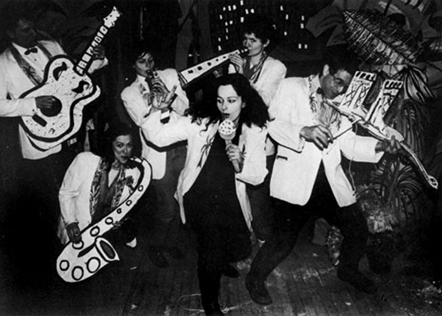 Publicity photo of the Cardboard Air Band at No Rio. From left to right, Walter Robinson, Ellen Cooper, Bebe Smith, Kiki Smith, Christy Rupp and Bobby G