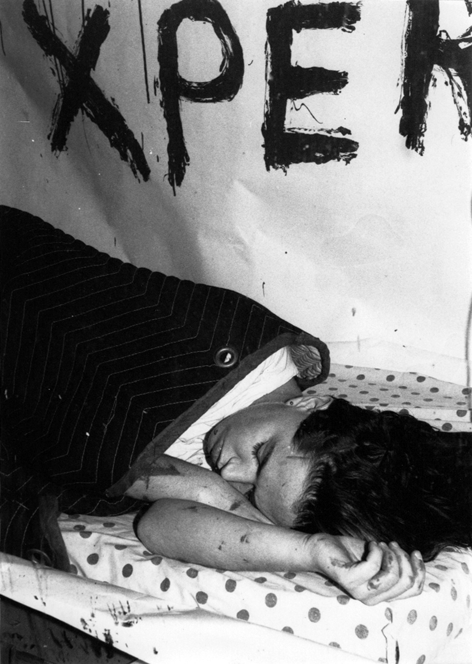 "Kembra Pfahler sleeps in the window of ABC No Rio as part of her performance installation, ""The New York Experience."" Photo by Toyo"