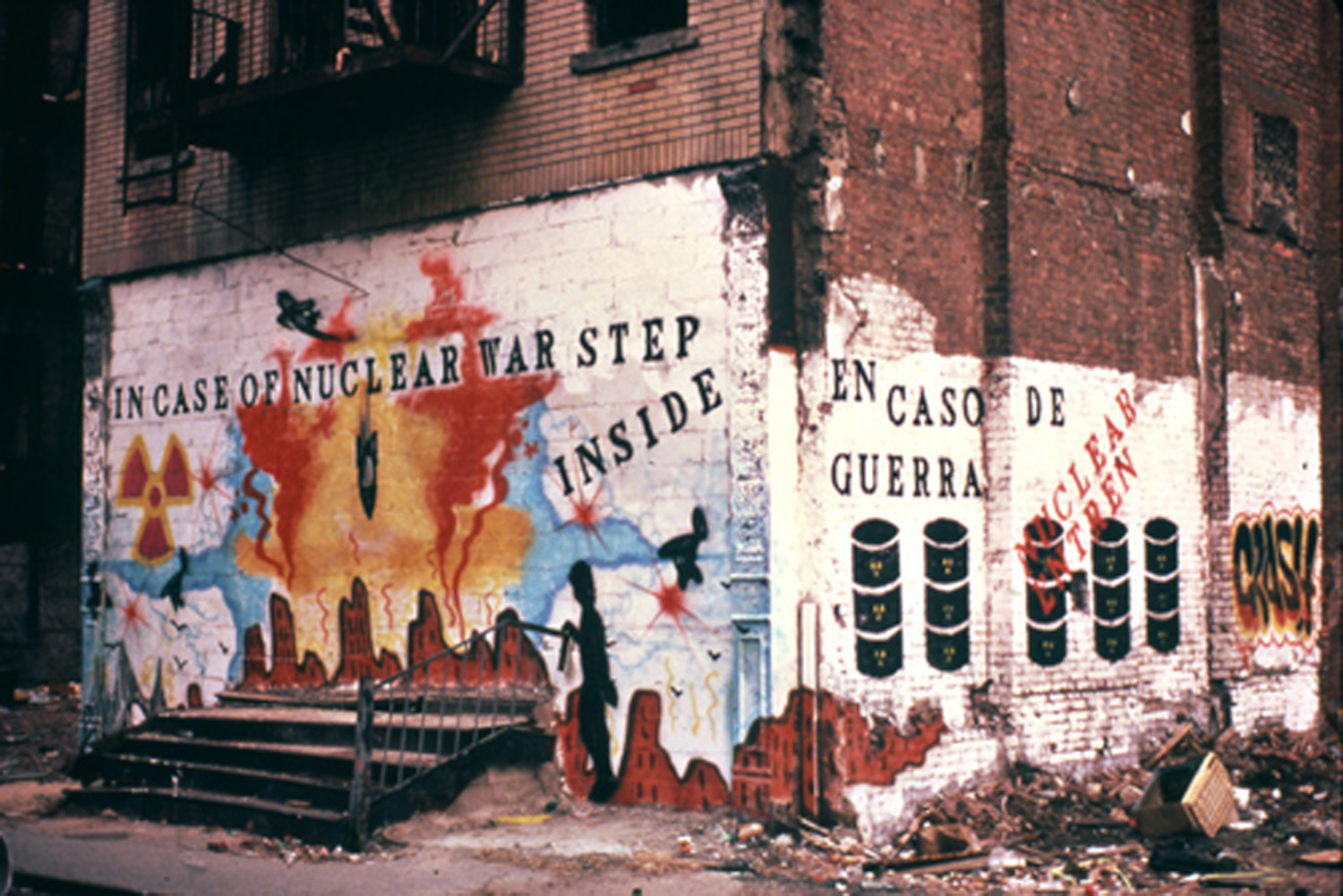 "John Fekner and Johnny ""Crash"" Matos,  Fallout Shelter Mural  on Suffolk Street. The building on which the mural was painted was knocked down shortly thereafter. Photo by Jack Fekner © 1981"