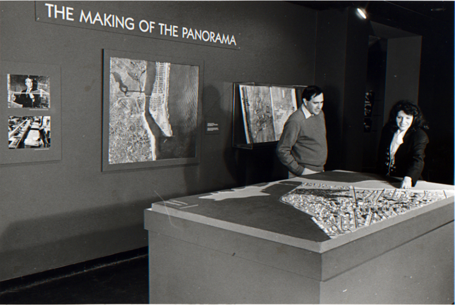 Marc Miller and Donna Tuman, curator of education, examine the never-installed Far Rockaway section of the Panorama, 1987.