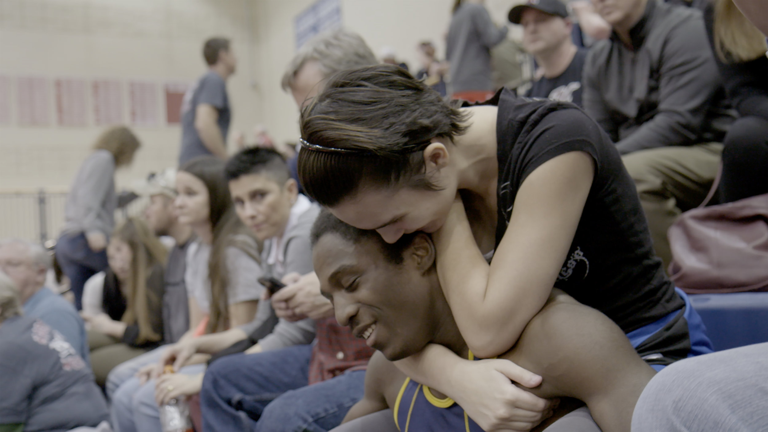 47_WRESTLE_Samara Heard and Jamario Rowe embracing at a tournament.jpg