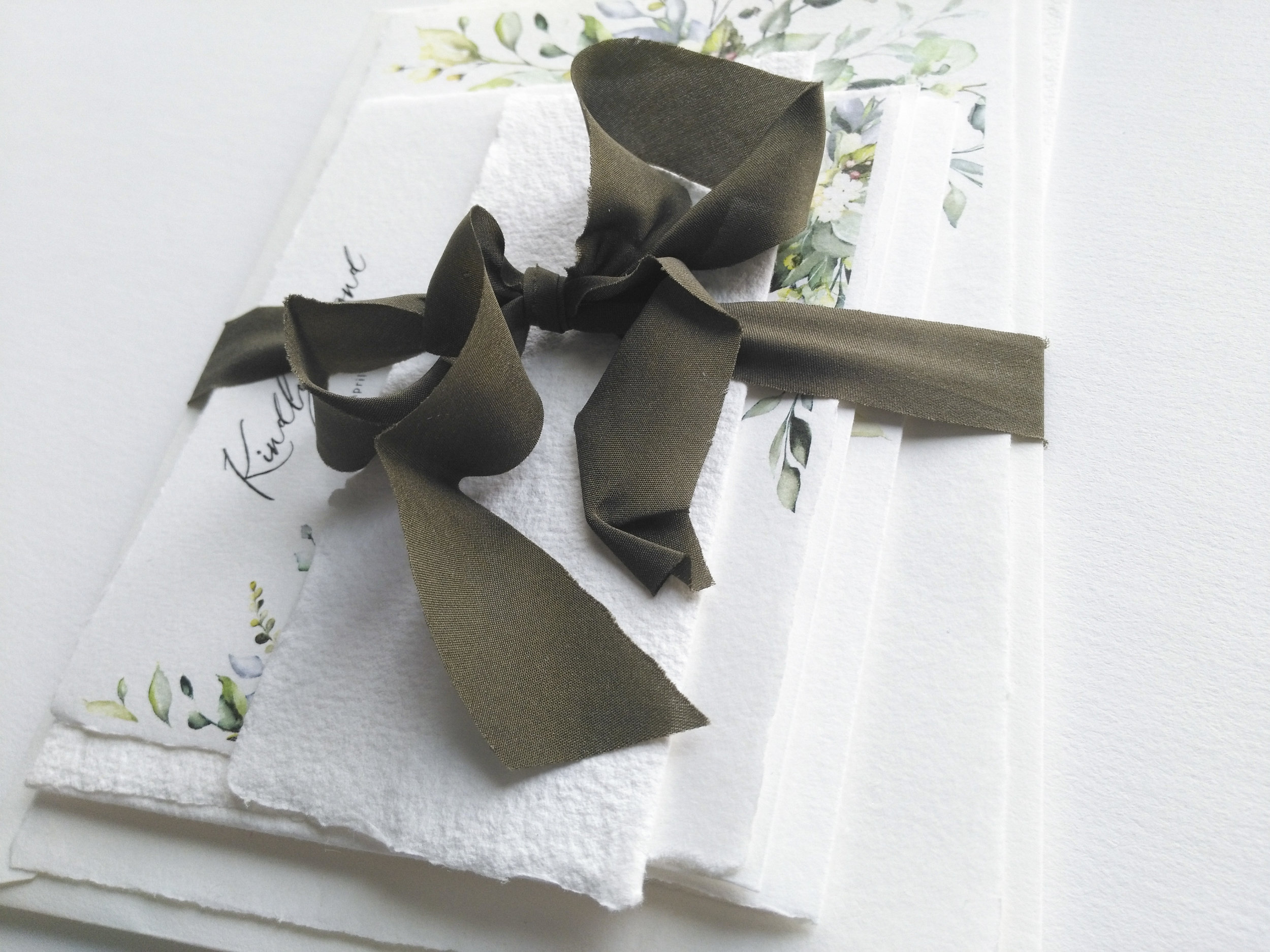 This picture is showing St. Gilles handmade paper, St. Gilles handmade envelopes and plant dyed silk ribbon. Click to enlarge.