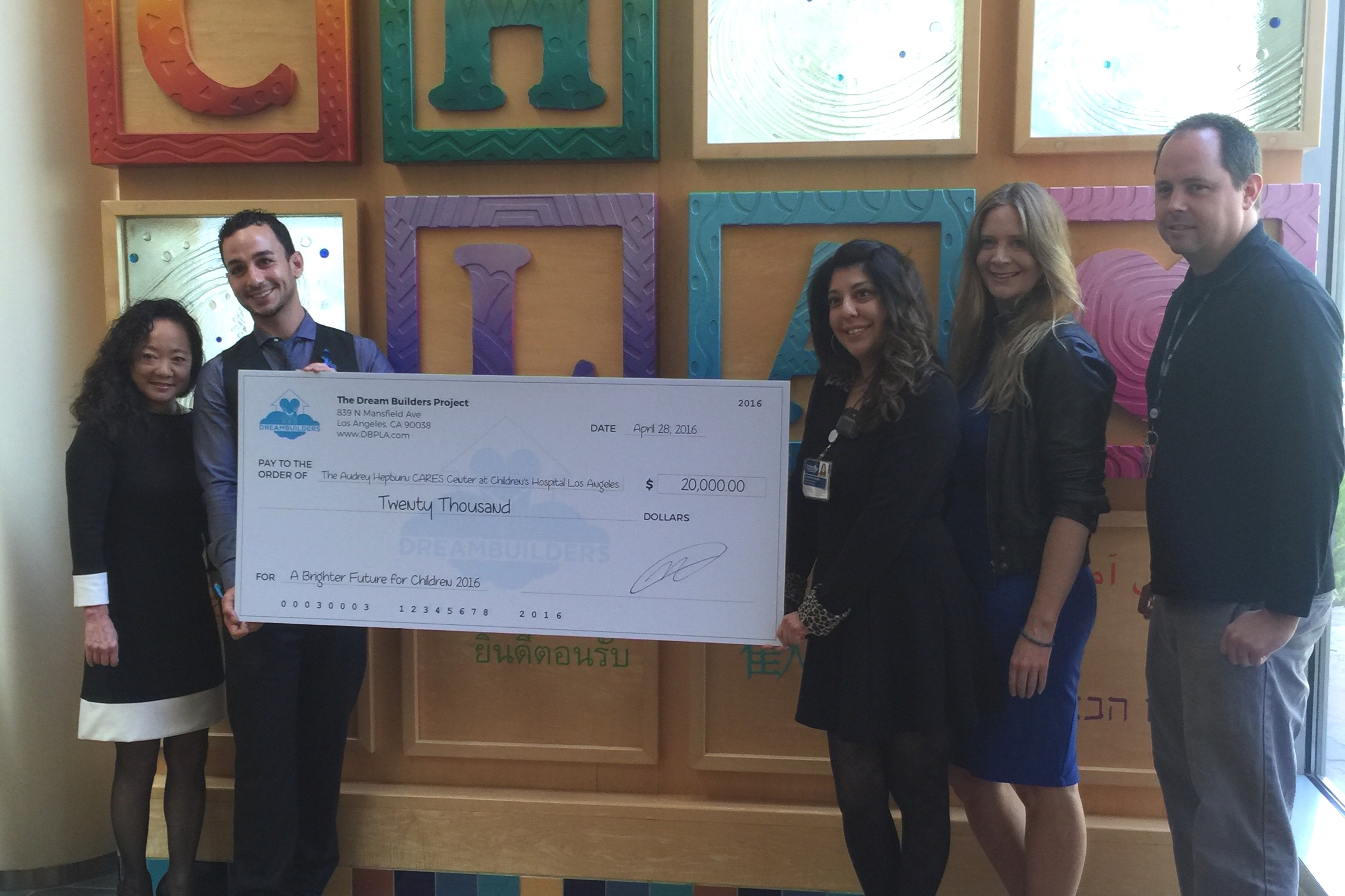 Presenting $20,000 to children's hospital los angeles -