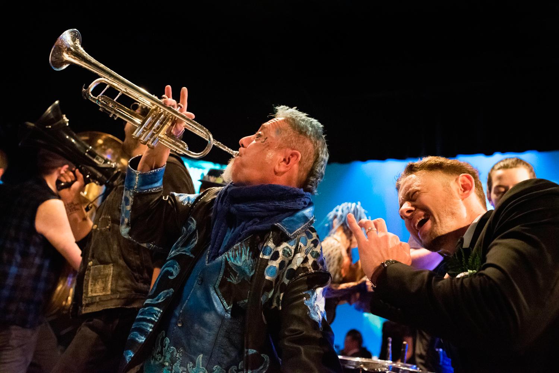 fremont studios auction musician with trumpet