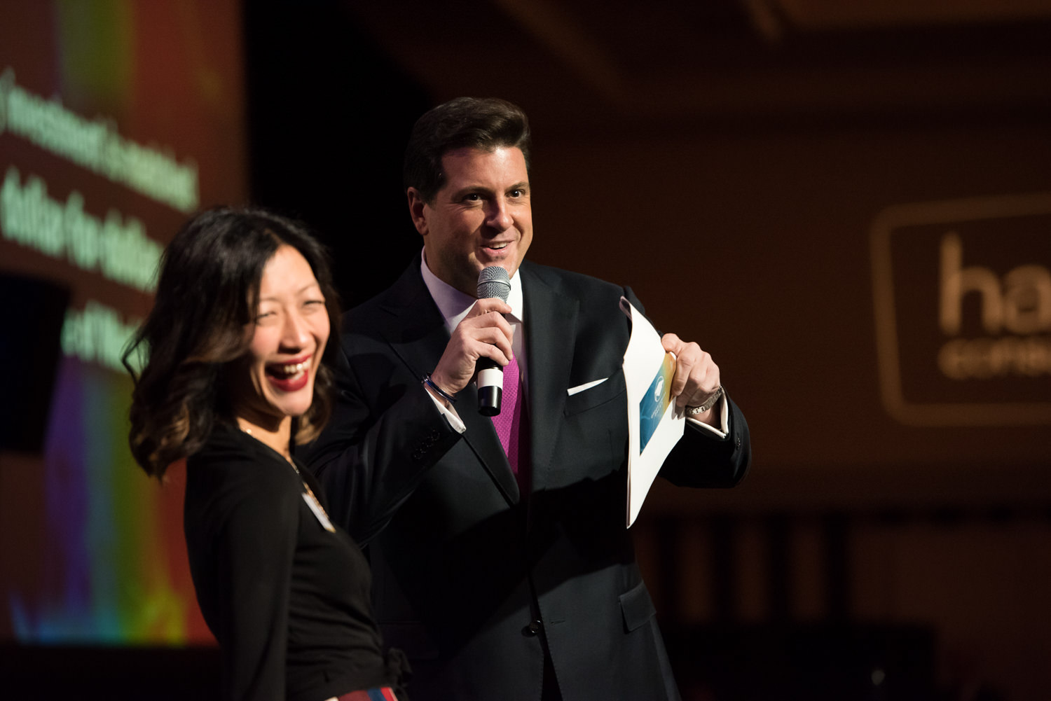 corporate luncheon emcees on stage