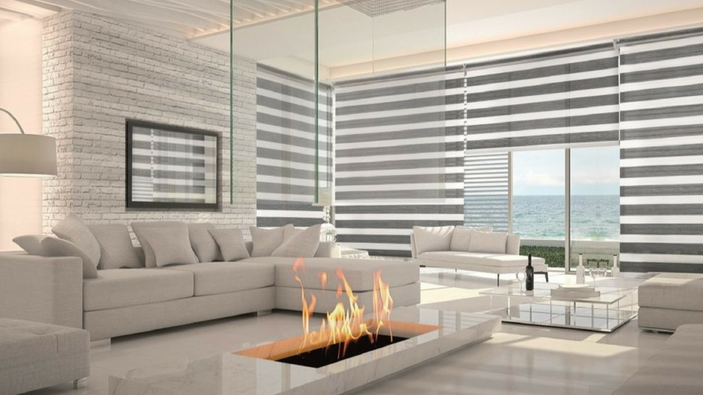 zebra shades - Alternate between appreciating your view while filtering out light and enjoying your privacy with Zebra Sheer Shades. These distinctive shades feature alternating strips of sheer and light filtering fabrics. You can raise these versatile shades fully for an unobstructed outside view or they can be lowered and adjusted with the sheer stripes aligned to filter any incoming light. If privacy is required, you will be able to simply align the stripes on the front and back panels of the shade to a closed position. What makes these different from other sheer shades is an absence of a horizontal vane connecting the front and back panels.