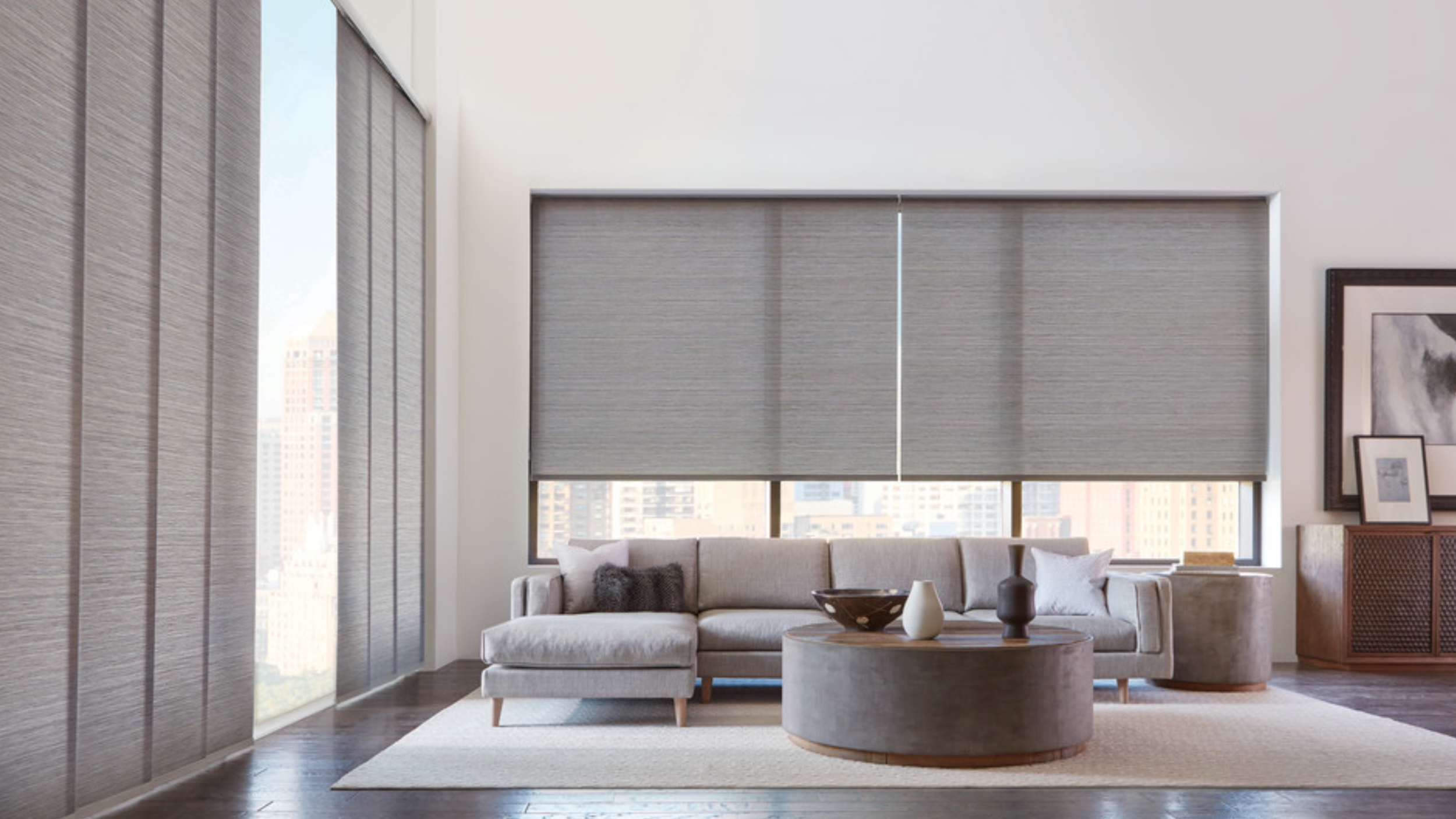 roller shades - Choose from a variety of opacity levels when you choose Premier Blinds Ltd for your residential or commercial roller shades. From sheer, light-filtering to complete blackout shades, you will be able to customize any room in your home to suit your unique style and taste. While custom roller shades are designed to make a statement on their own, they also pair beautifully with custom drapery. Used separately or with complementary custom window treatments, these shades are available in a wide range of gorgeous fabrics, including grass-like weaves, which can be coordinated with most sliding panels. Plus, with roller shades, your furnishings receive the UV protection you need without sacrificing your view to the outside.