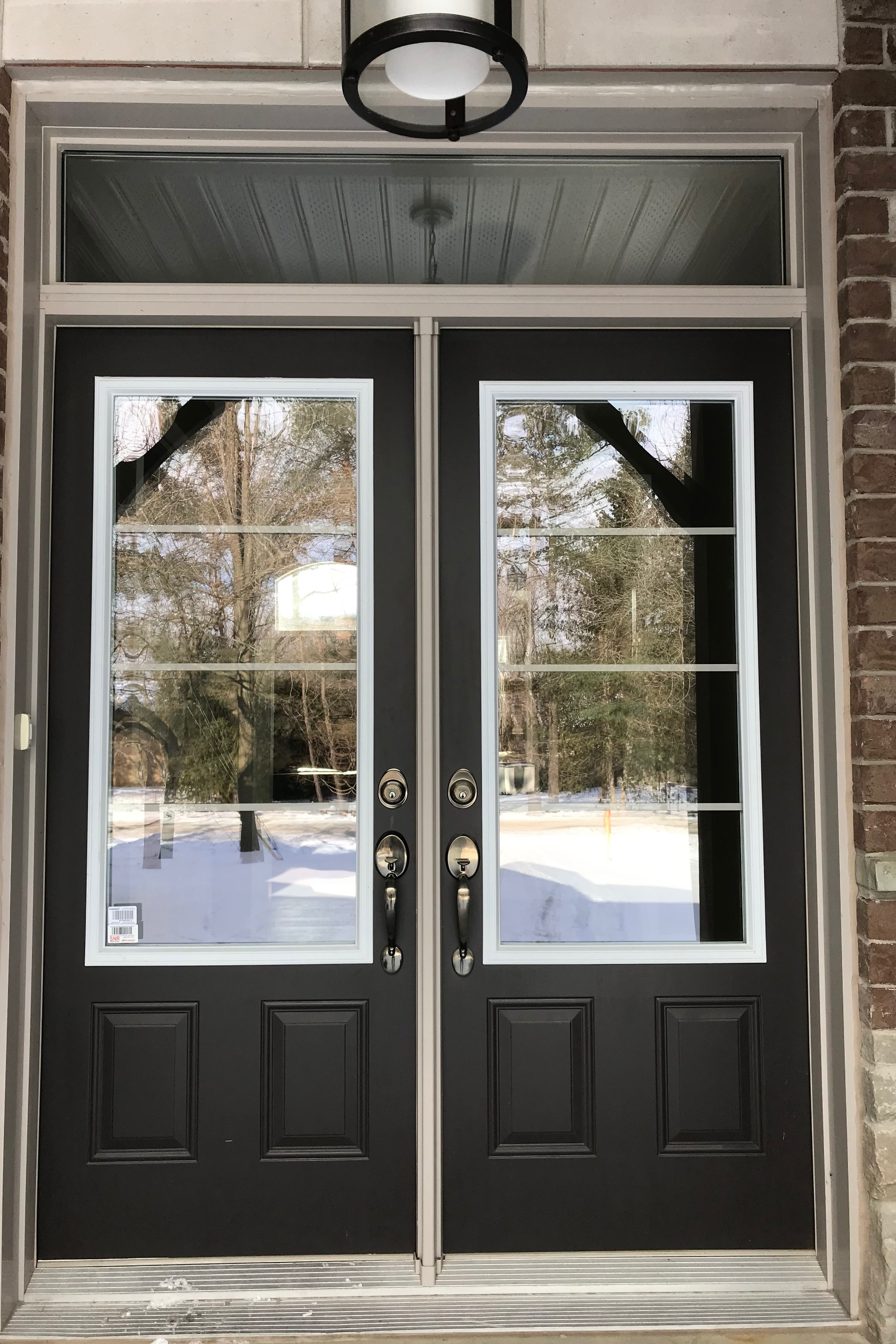 All exterior man door frames are finished in vinyl to match your windows. Front Entry doors with Grip Sets. 3/4 height glazing to doors. - No more exterior man door frames to paint!