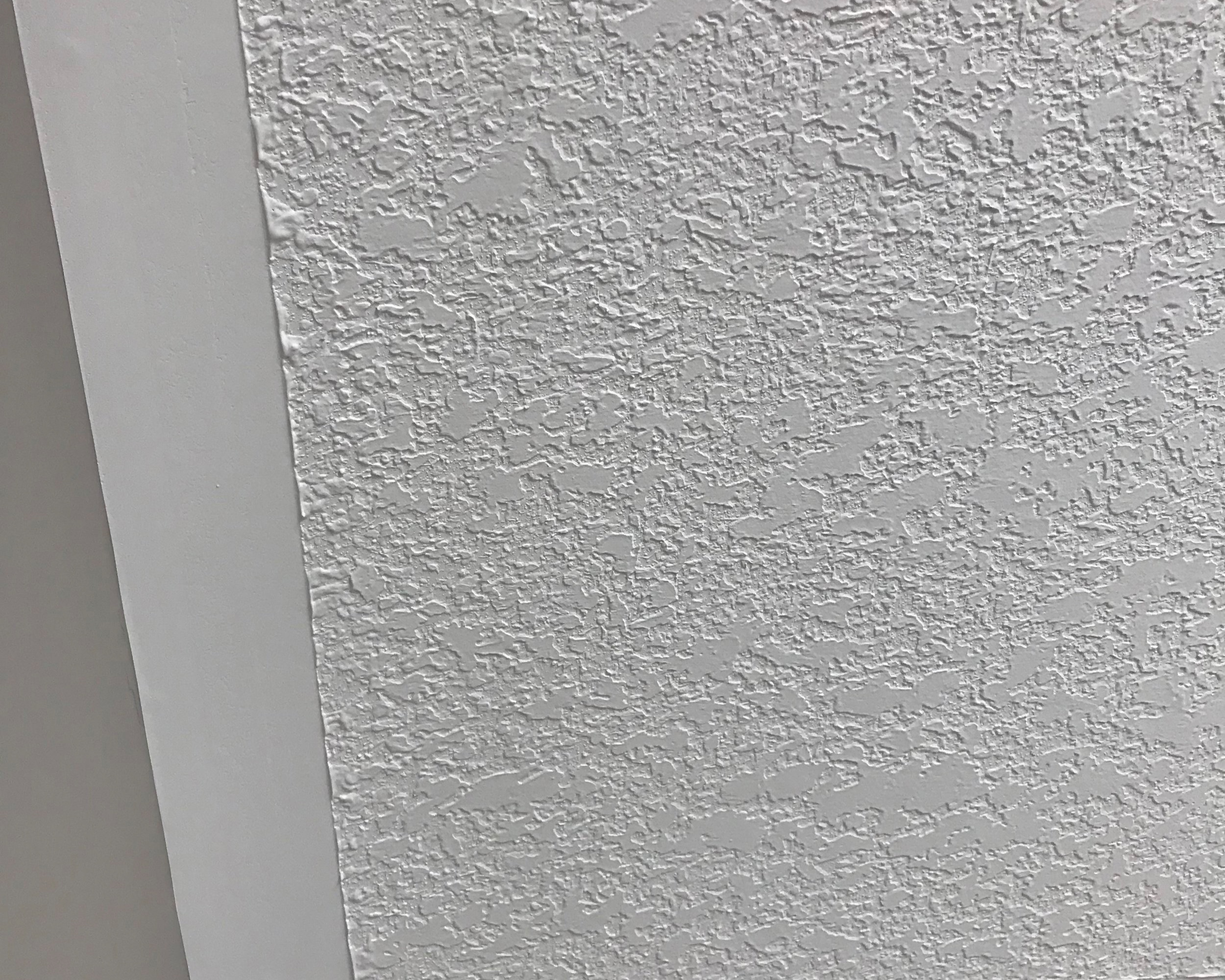 """Knock-down ceilings with 4"""" borders are standard. - Gone are the days of stippled or """"popcorn"""" finishes."""