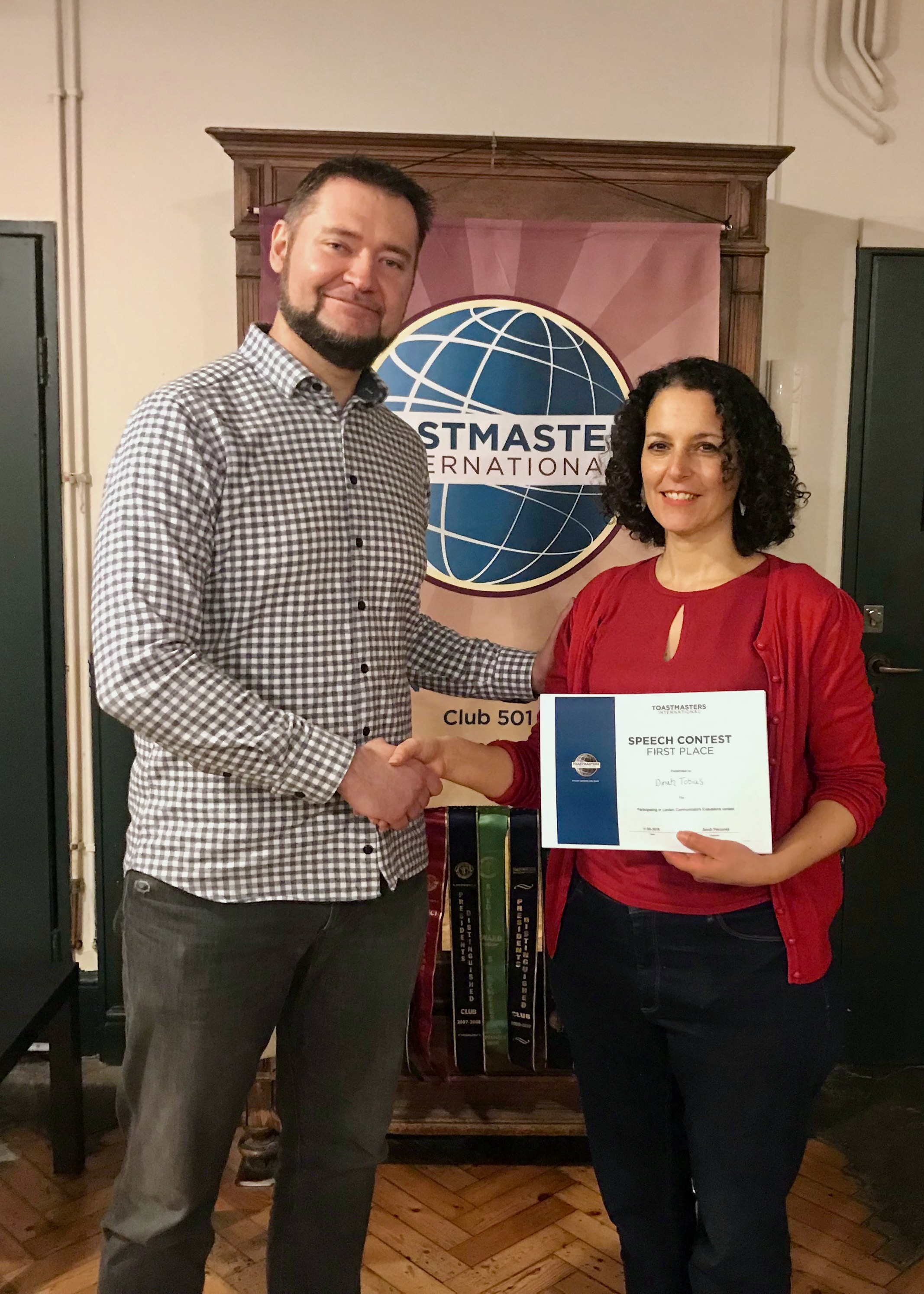 Jake presenting Dinah, our Club President and the evaluation contest winner, with the certificate.