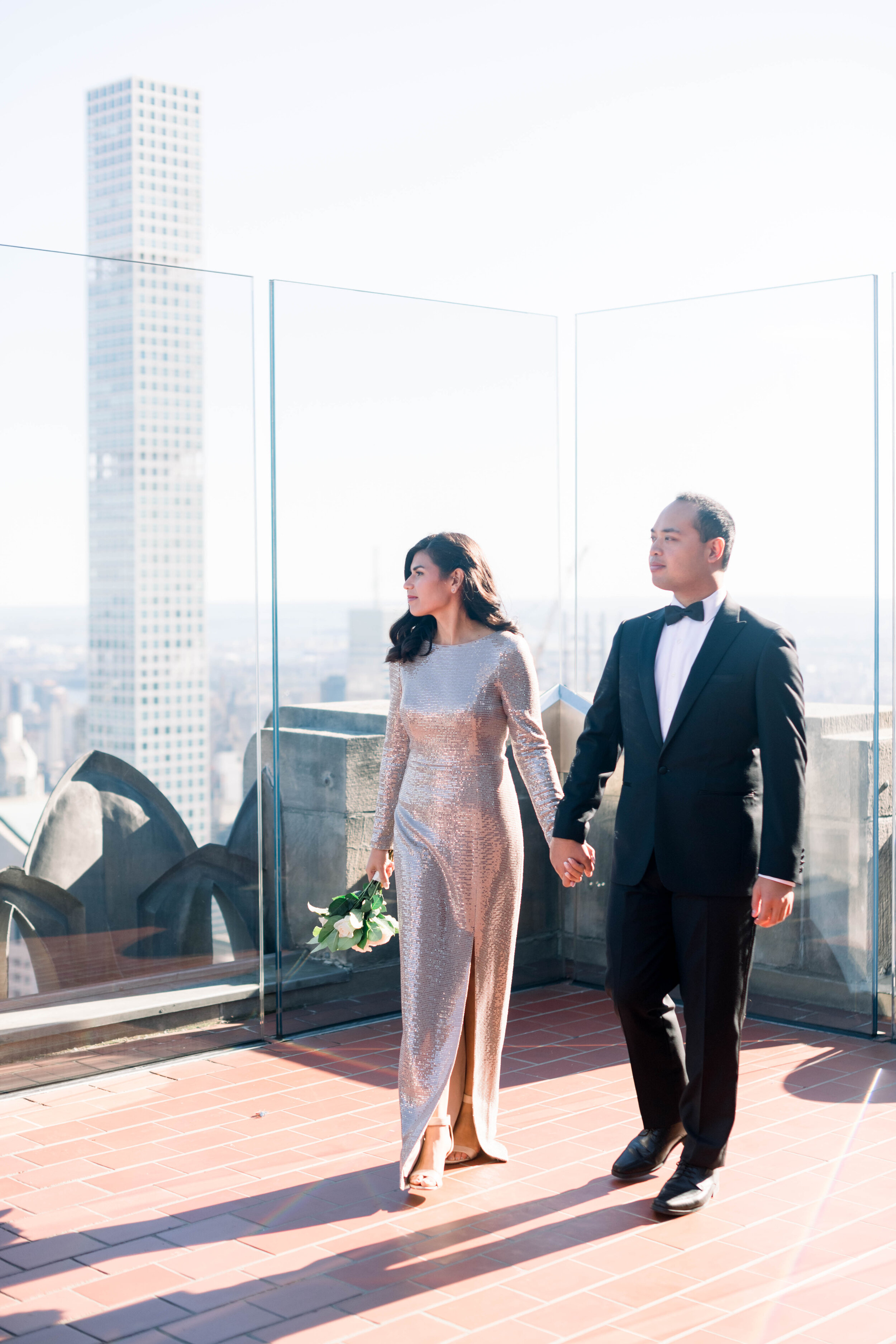 top of the rock+engagement+nyc engagement+NYC elopement+sparkly wedding gown+white bouquet+modern wedding