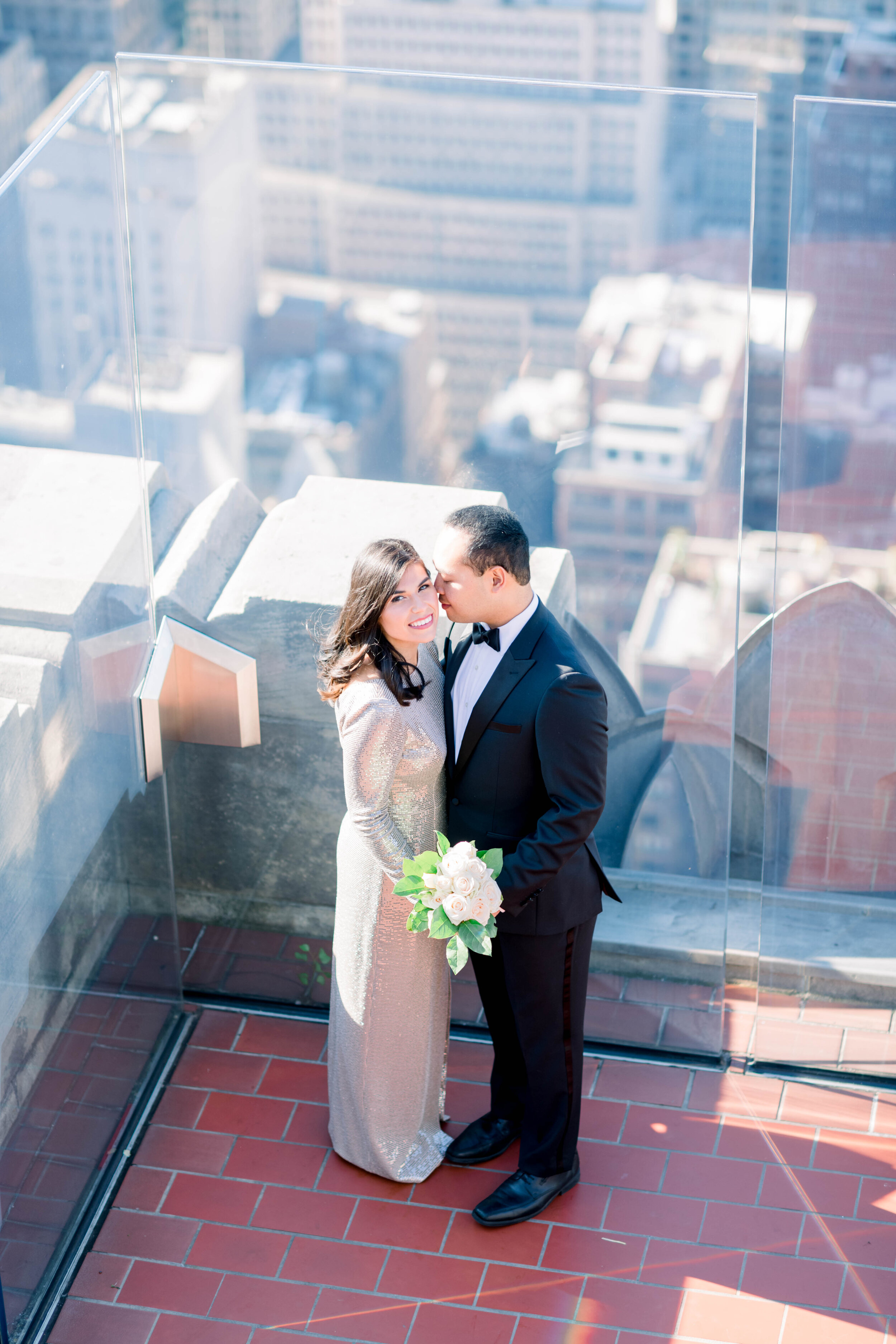 top of the rock+engagement+nyc engagement+NYC elopement+sparkly wedding gown+gold wedding gown+white bouquet+modern wedding