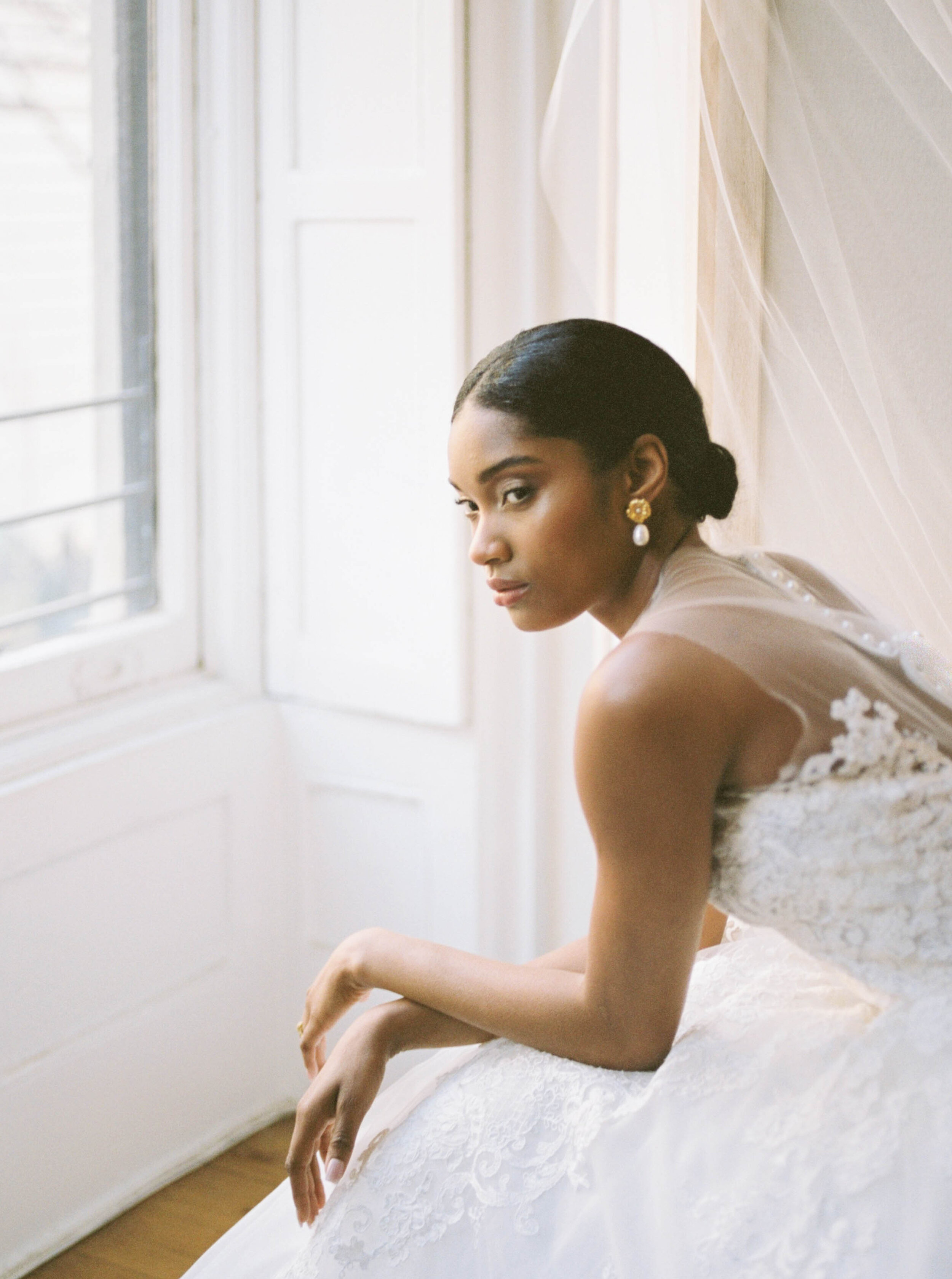 New York City Bridal Editorial featuring Reem Acra wedding gown and monochrome white bouquet by Liz Andolina