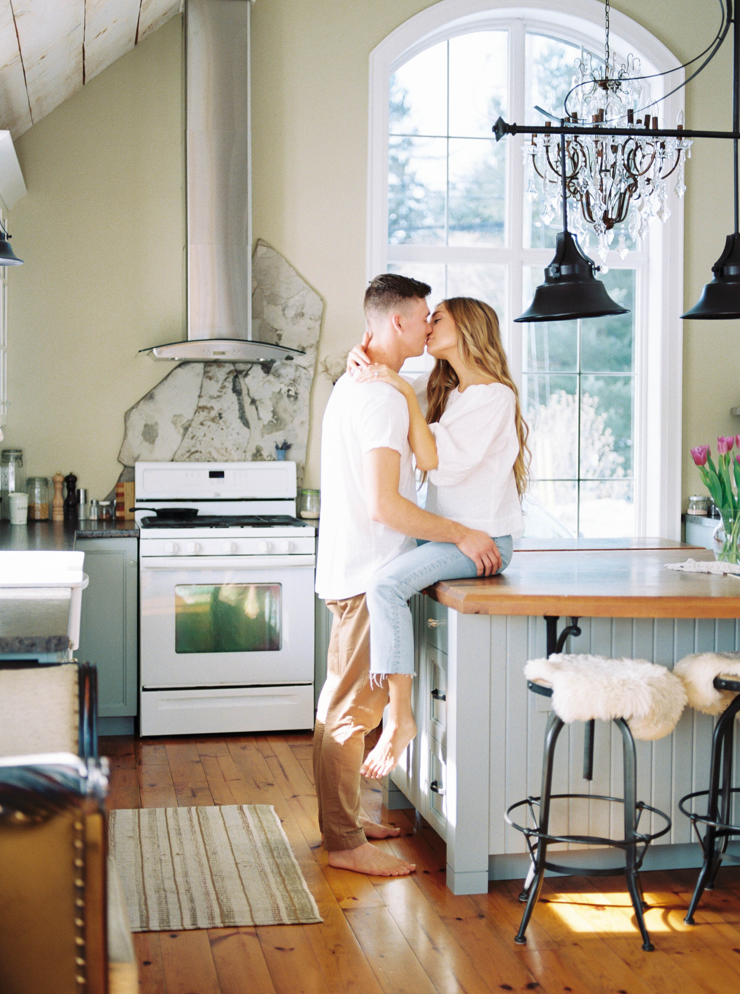 Lifestyle couple session on film in beautiful airy kitchen at Woodland Weddings