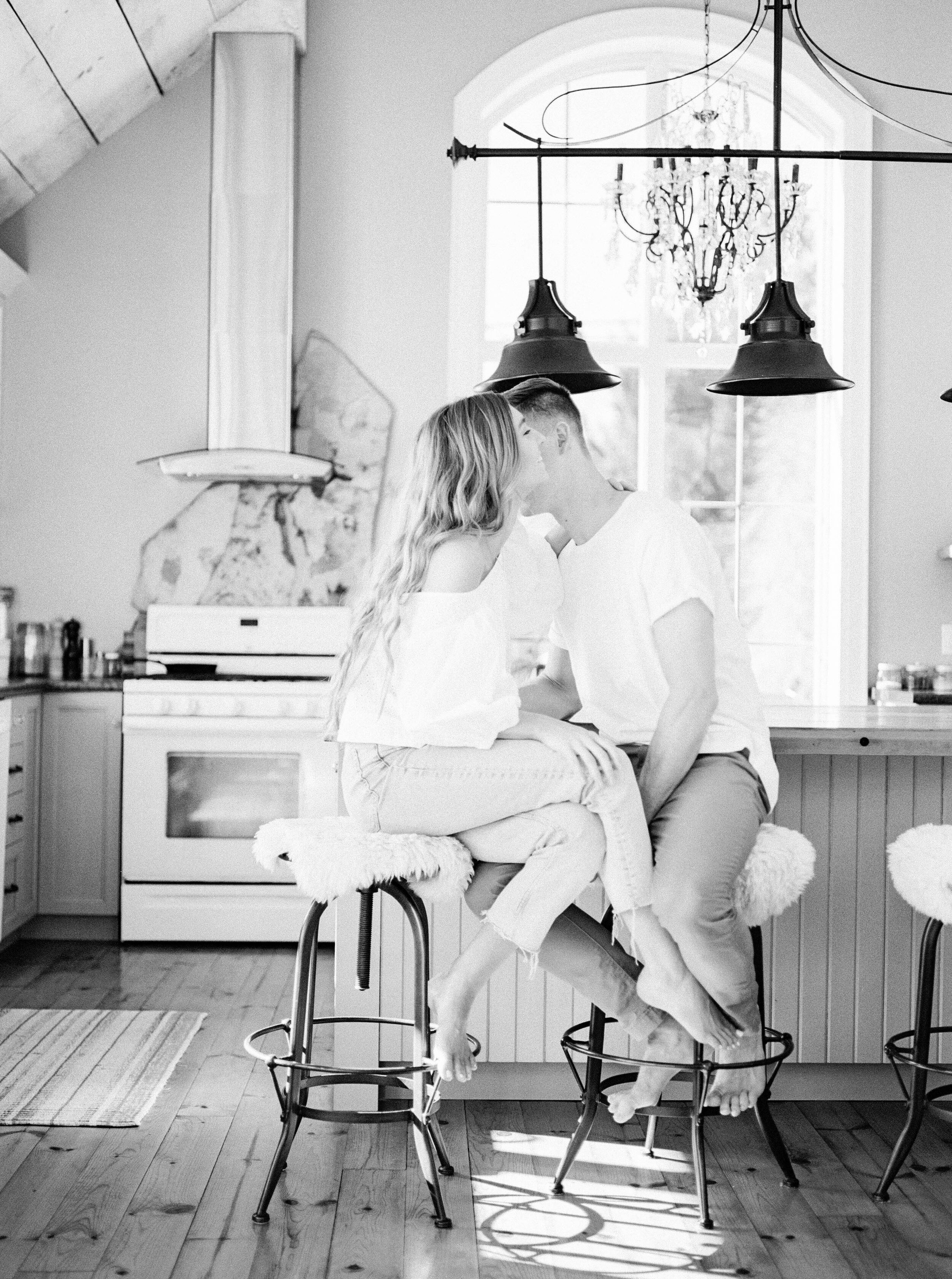 Lifestyle couple session in beautiful airy kitchen at Woodland Weddings