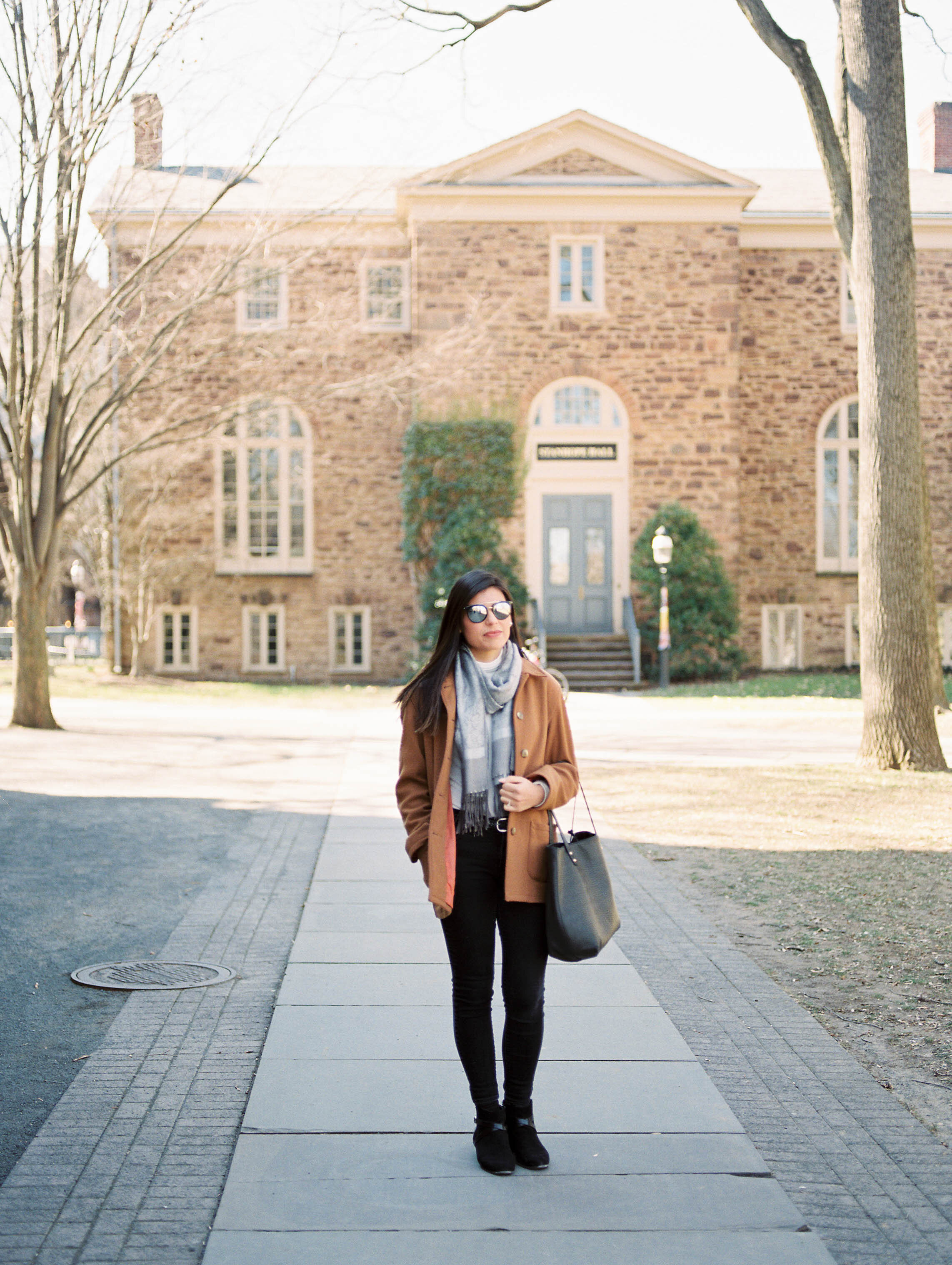 Outdoor lifestyle couples session with beige coat, coffee, shopping in Princeton New Jersey on Princeton University Campus by Liz Andolina Photography