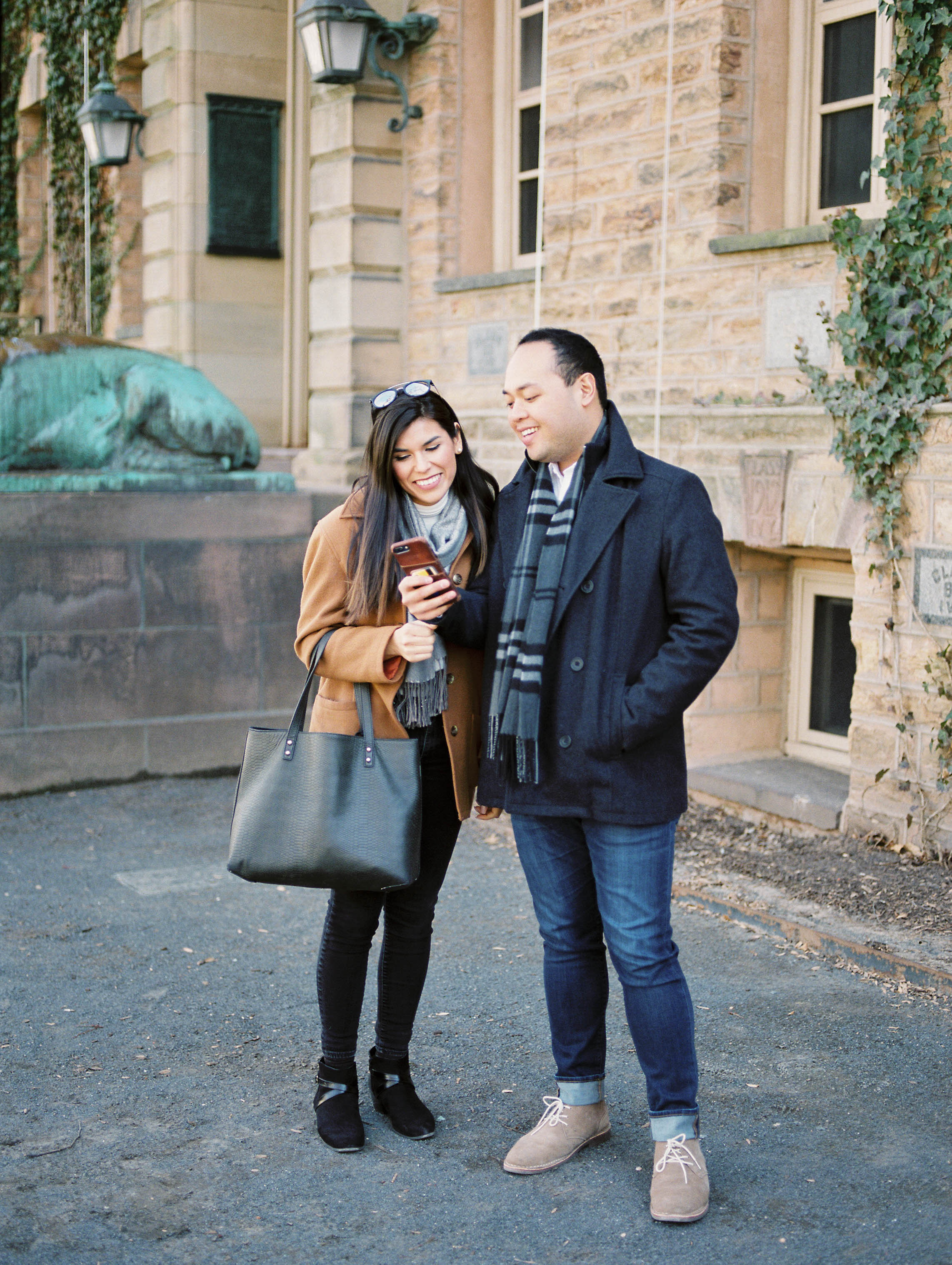Outdoor lifestyle couples session with beige coat, sunglasses, coffee, shopping in Princeton New Jersey on Princeton University Campus by Liz Andolina Photography
