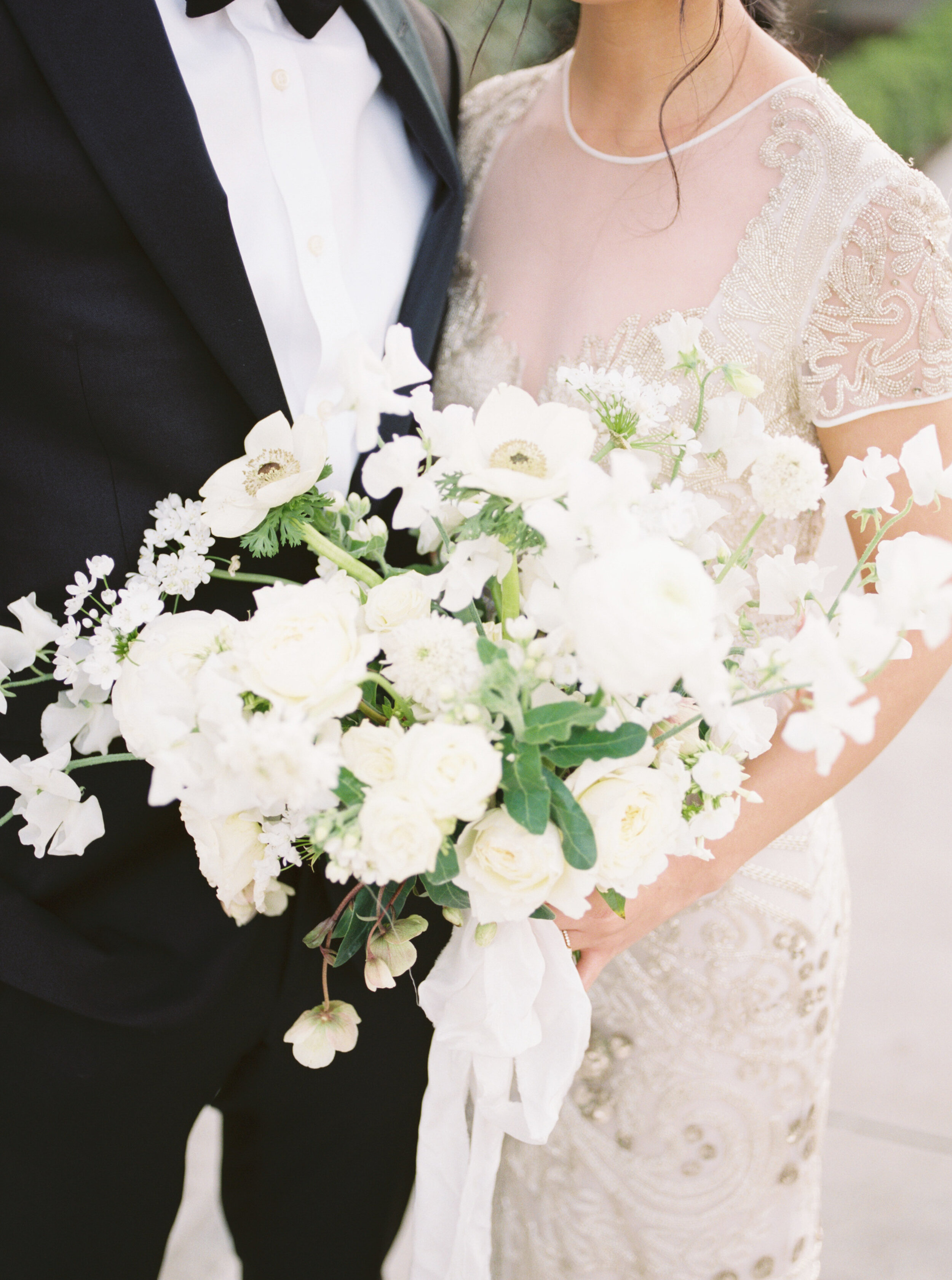 Elegant and romantic old Hollywood wedding with beaded Naeem Khan wedding gown, white organic florals, and epic sunset views at Griffith Observatory in Los Angeles by Liz Andolina Photography