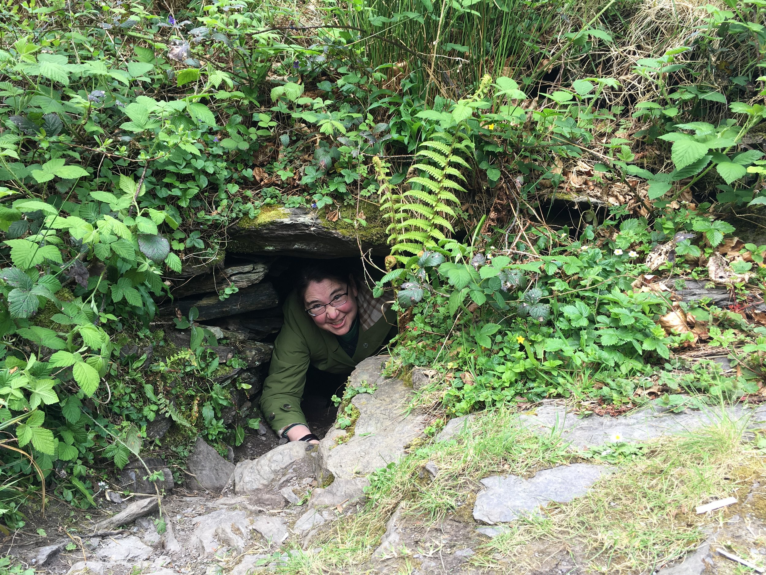 Susan climbs out of a souterrain.