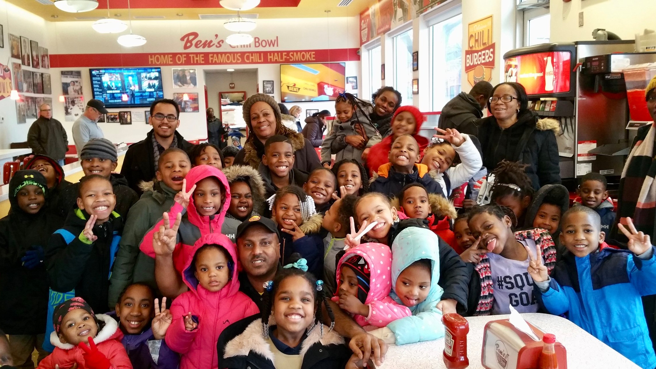 A happy group of students stops by Ben's Chili Bowl on H ST NE.