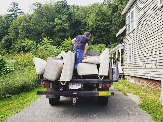 Friends who move couches on farm trucks