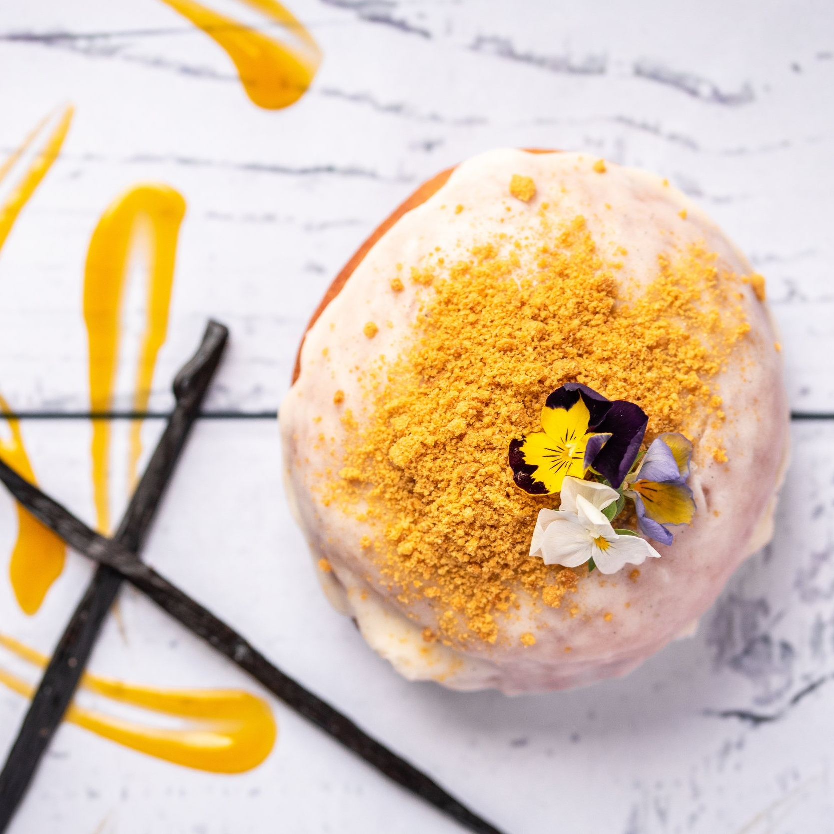 Tropical Mango & Passionfruit - Signature Sourdough filled with a beautifully Tropical Mango & Passionfruit Curd topped off with a Sweet Madagascan Vanilla Bean Glaze and crunchy Gingernut Crumble.*Allergen advice
