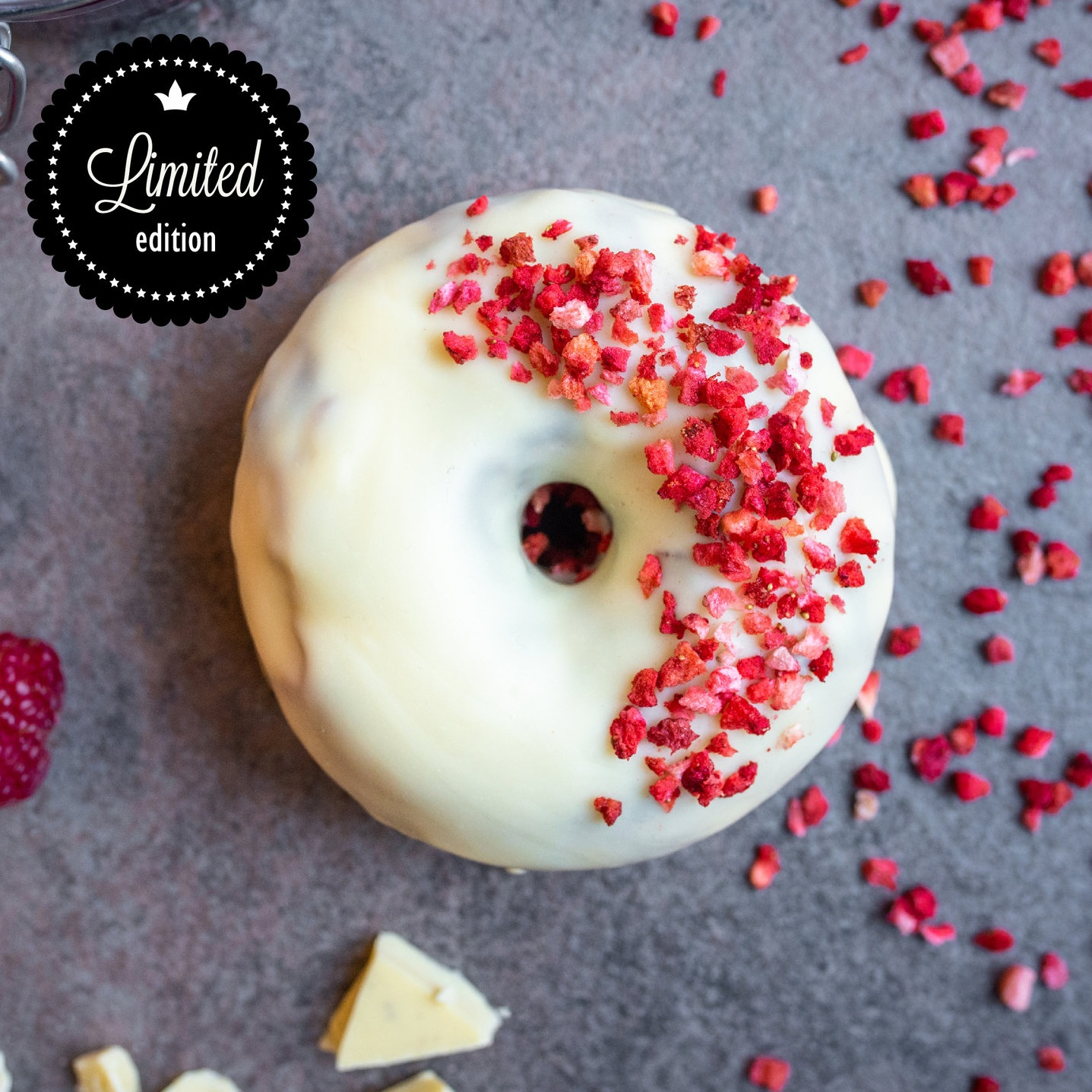 White Chocolate Ring - Signature sour dough wrapped in white chocolate with a half coating of freeze dried raspberries.*Allergen advice