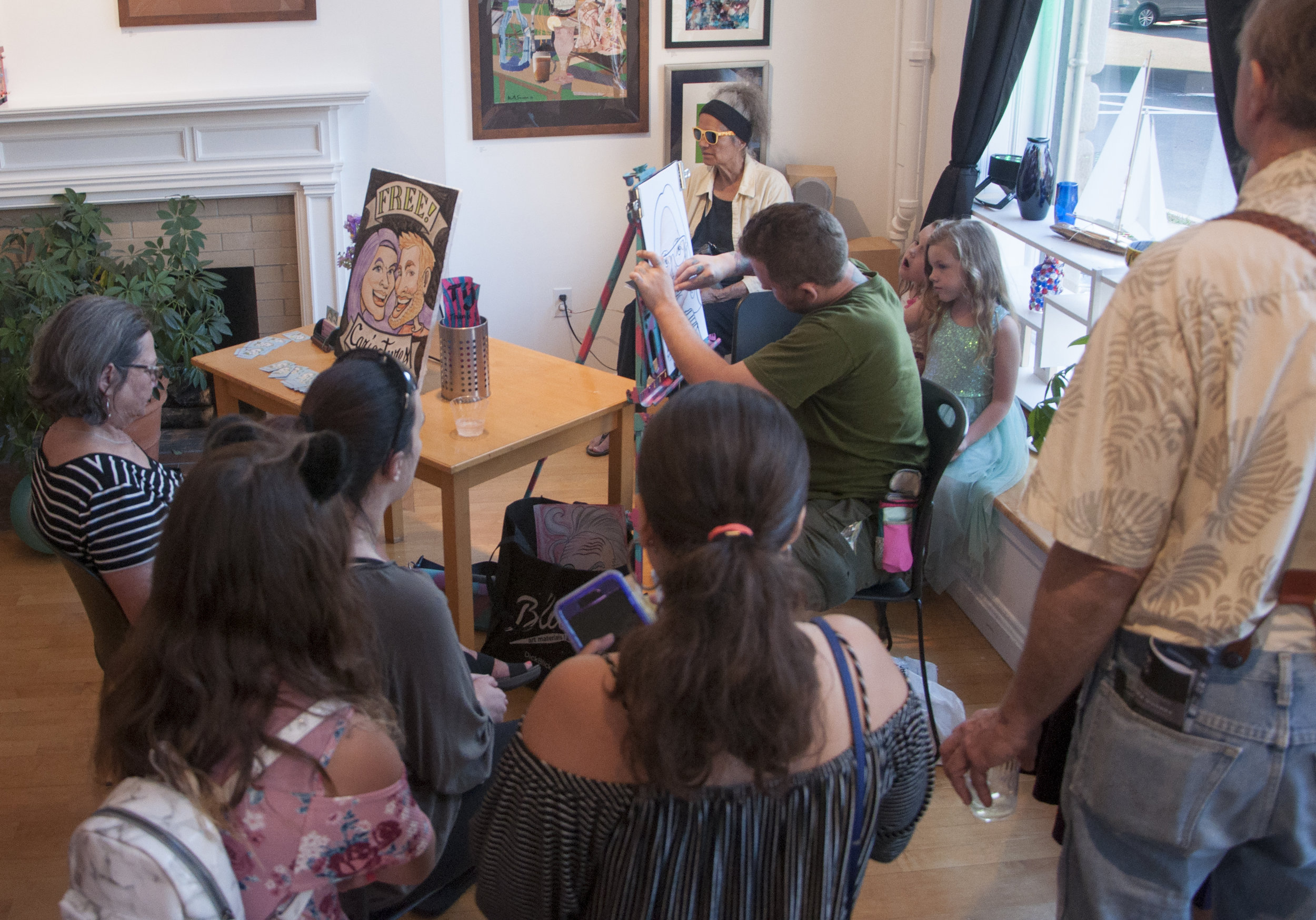August 2, 2019 Higher Purpose Opening Reception. Matt Bernson Caricature Artist. Photo credit Vacant Skye Photography.