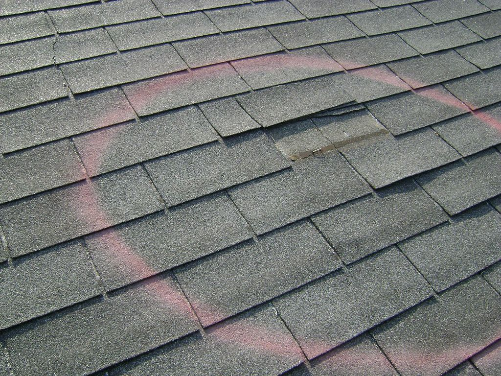 Wind Damage - Assessing storm damage caused by wind is not so cut and dry. Residential asphalt shingles are designed to self-seal by way of a tar strip adhering to a match point on each shingle. During a windstorm this tar strip can unseal and the shingle can lift. A lifted shingle alone is not considered damaged. However, if wind-blown debris attaches to the tar strip during the storm and prevents the shingle from re-sealing, then the shingle is damaged beyond repair. A free roof inspection from one of our expert roofers will help identify potential wind damage.