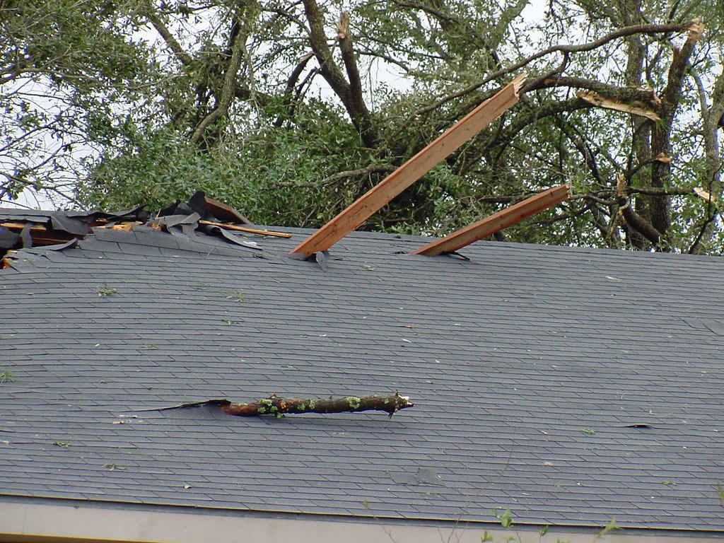 Flying Debris Or MISC. Item - This is usually a tree branch or similar object which falls, impacts the structure, and causes damage. Don't assume your roof is fine after a storm simply because it appears to be intact. Most storm damage is not visible from the ground or to the untrained eye. Bermudx Roofing Of Spring Texas will provide a free roof inspection to determine if your roof is still working properly and fully protecting your home.